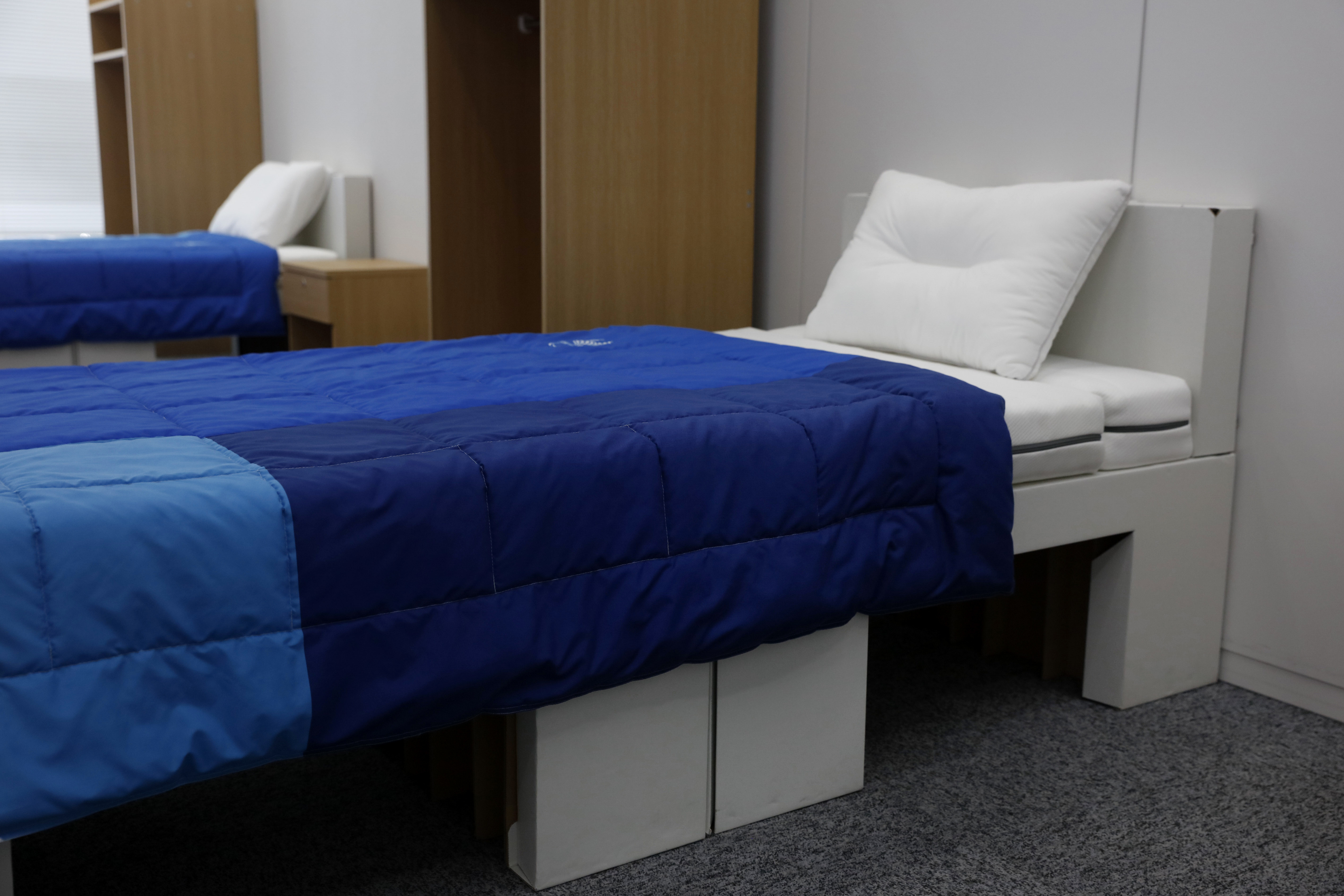 Two sets of bedroom furniture, including cardboard beds, to be used in the Athletes' Village at the Tokyo 2020 Olympic and Paralympic Villages are shown in a display room on Jan. 9, 2020, in Tokyo.