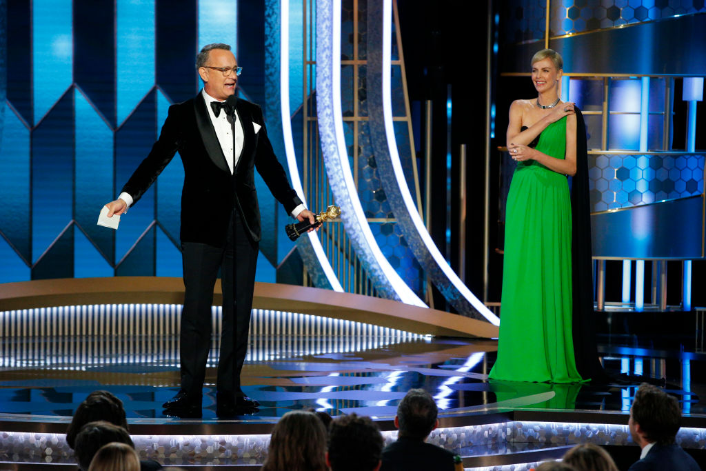 Tom Hanks accepts the Cecil B. DeMille Award, presented by Charlize Theron, onstage during the 77th Annual Golden Globe Awards.