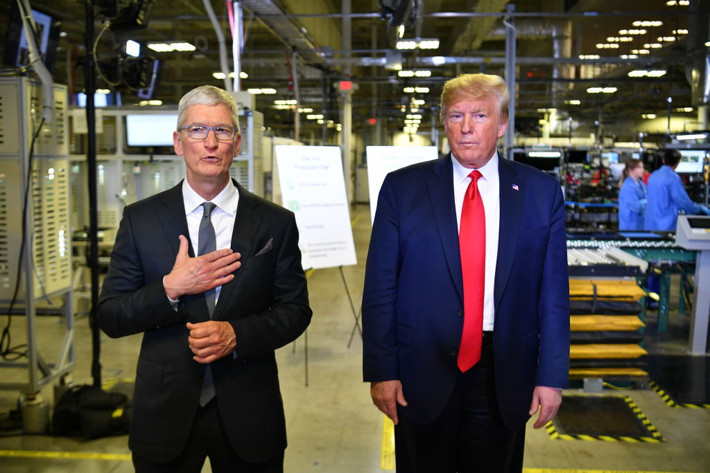 President Donald Trump and Apple CEO Tim Cook speak to the press during a tour of the Flextronics computer manufacturing facility where Apple's Mac Pros are assembled in Austin, on Nov. 20, 2019.
