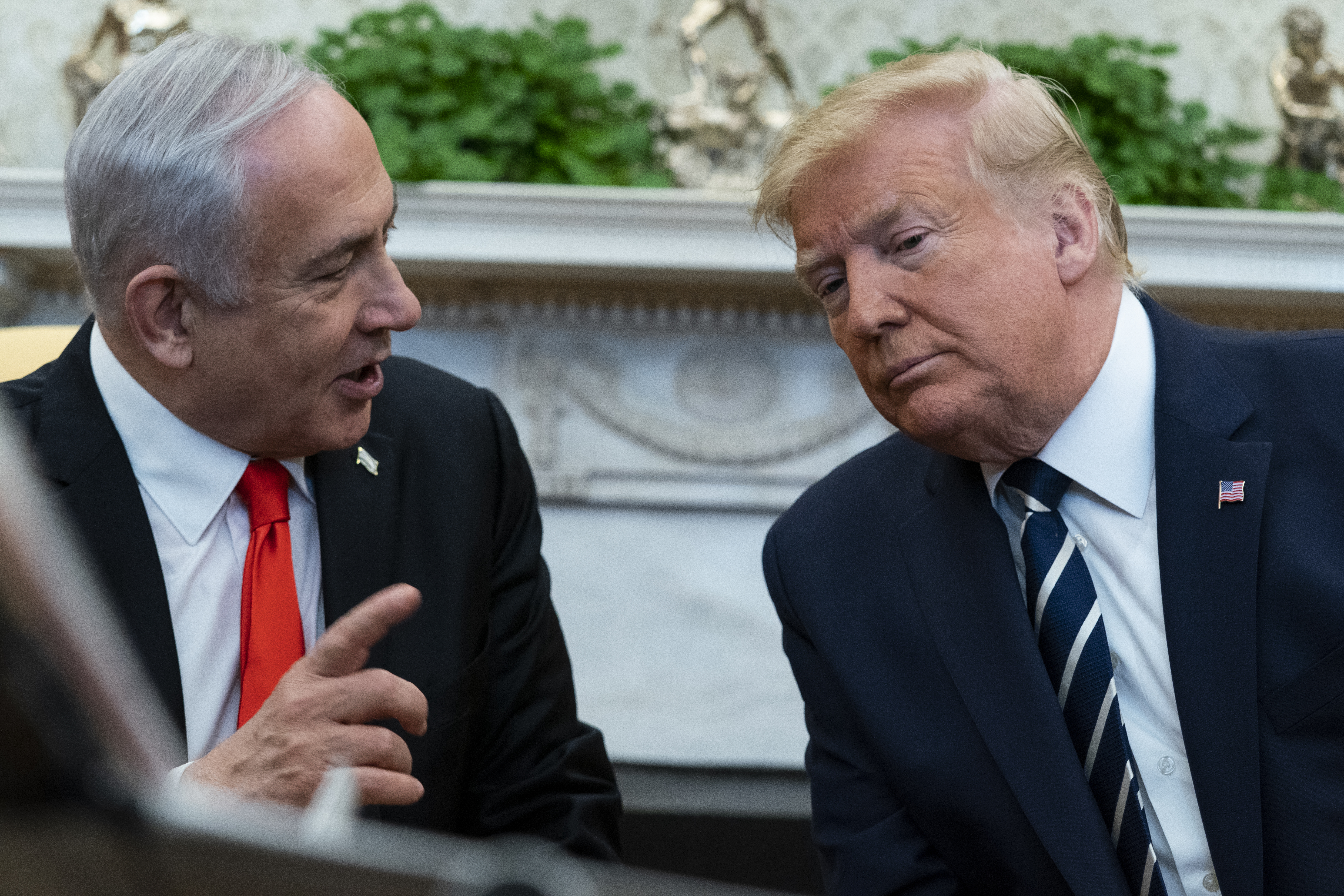 President Donald Trump listens to Israeli Prime Minister Benjamin Netanyahu during a meeting in the Oval Office of the White House, on Jan. 27, 2020, in Washington.