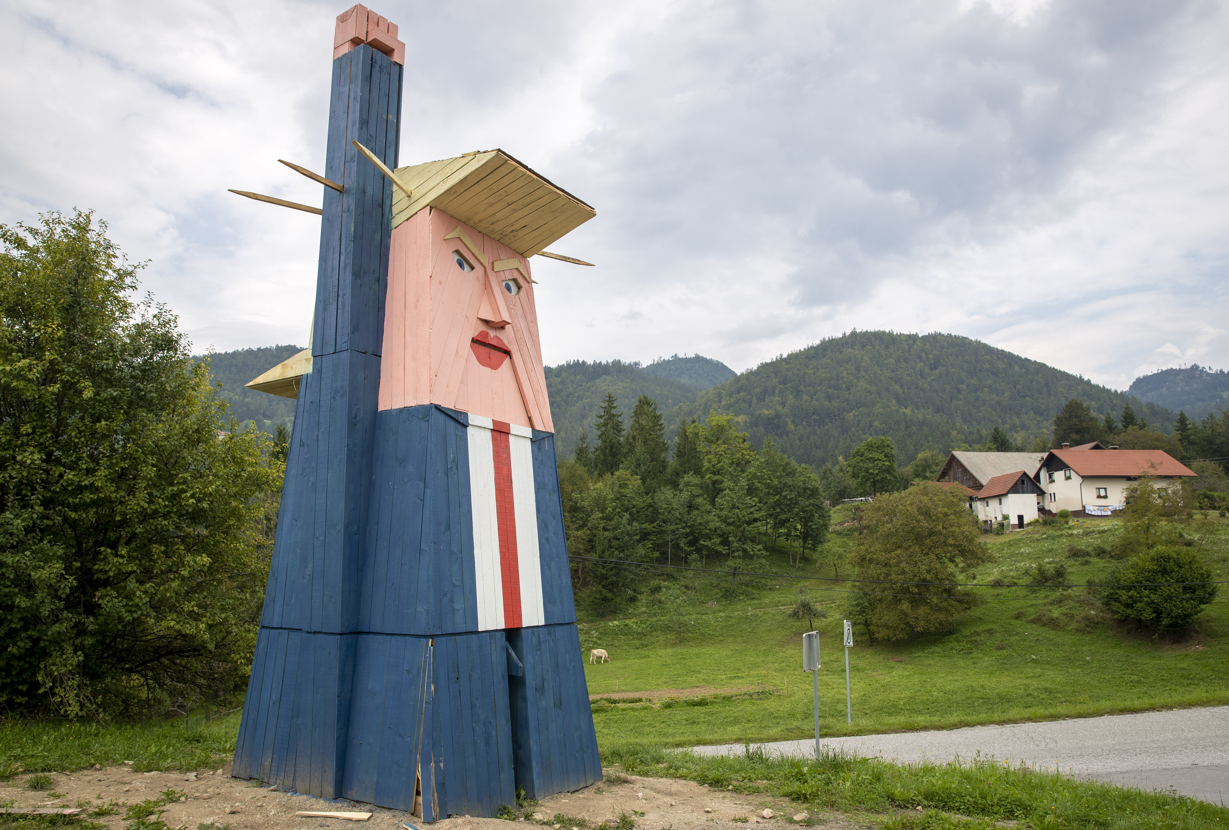 This file photo from Aug. 30, 2019 shows a wooden statue of Donald Trump near Kamnik, Slovenia.