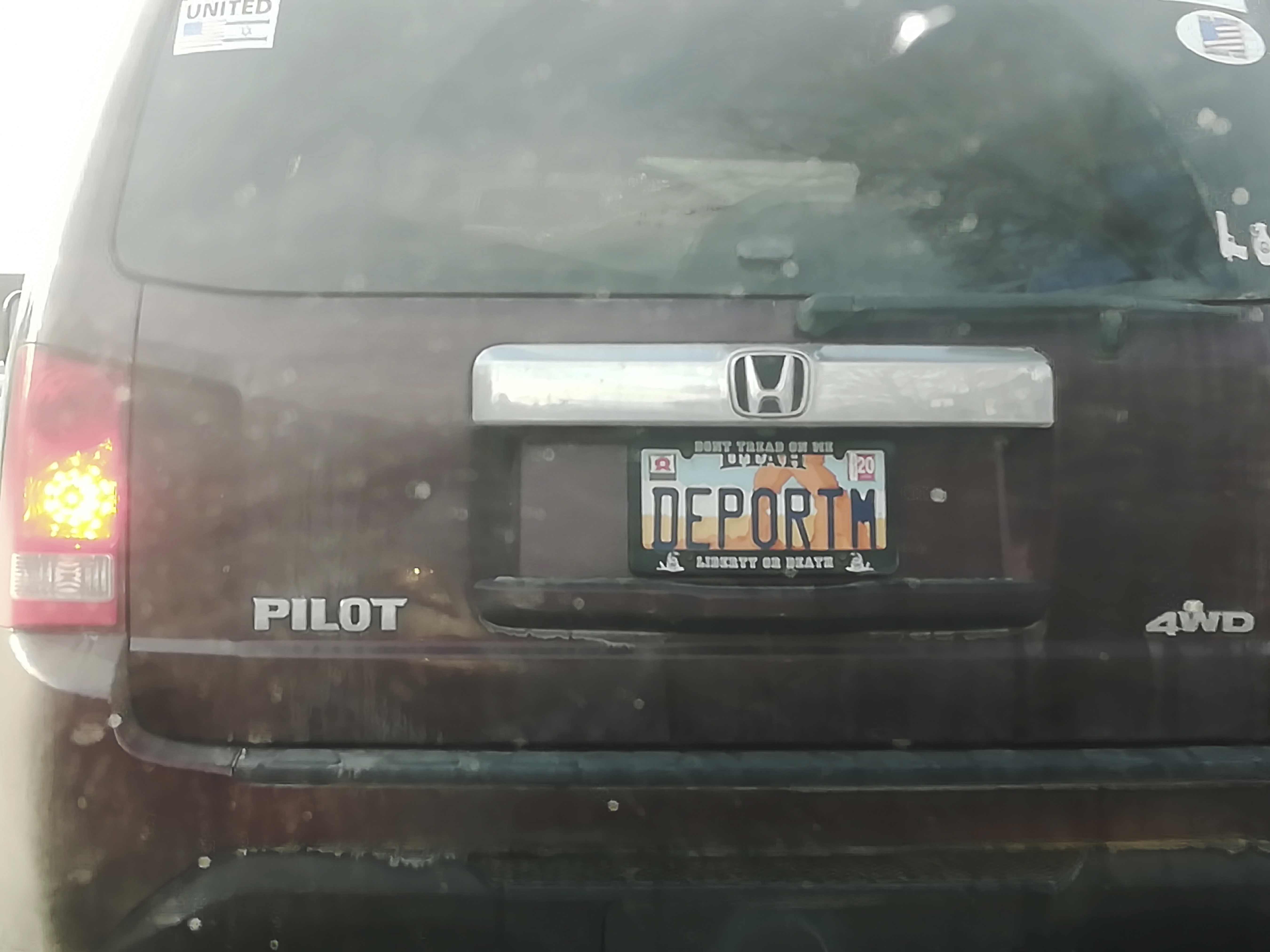 This photo, provided by Matt Pacenza, shows a license plate reading  DEPORTM  on a vehicle registered in Utah.