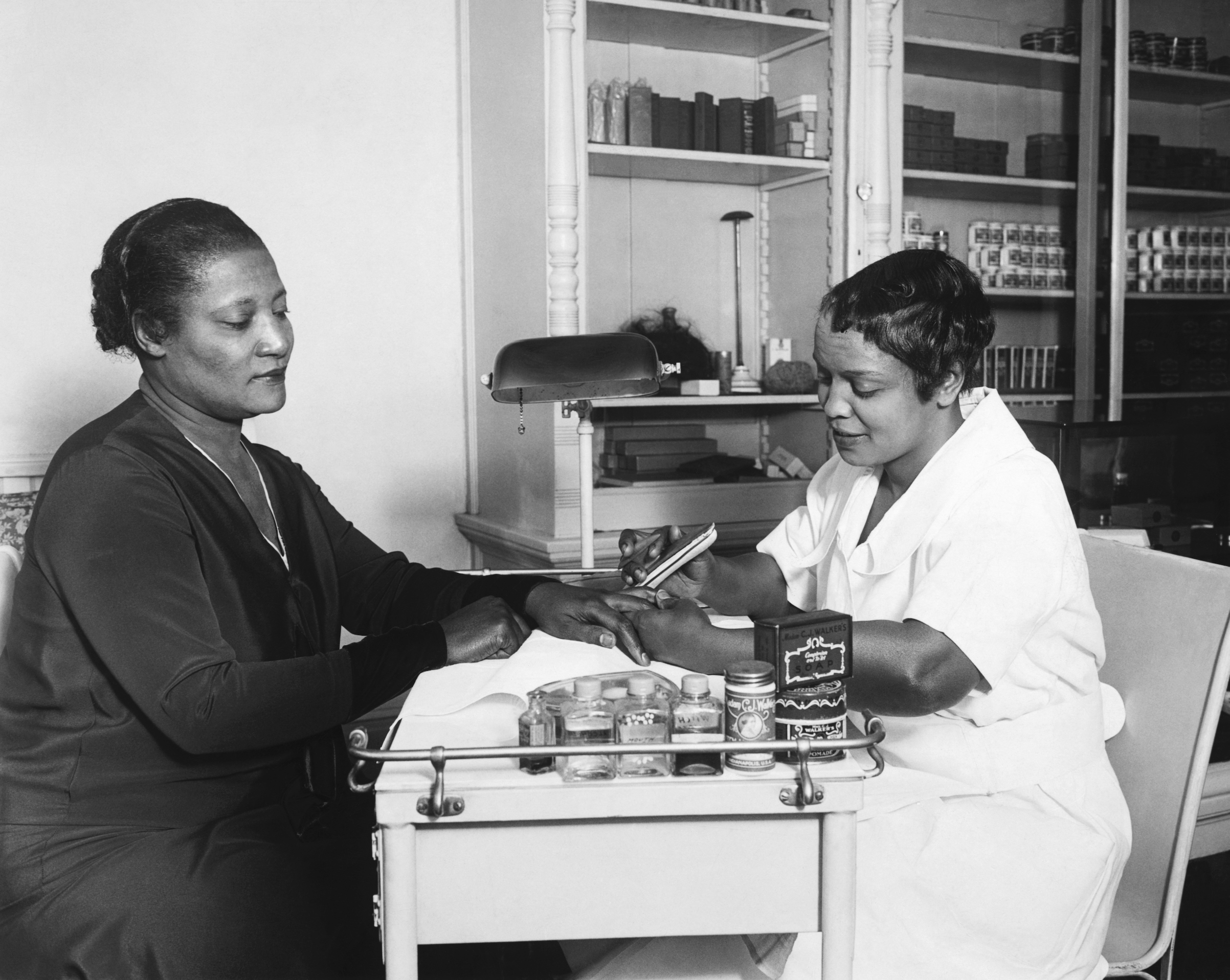 A'Lelia Walker, daughter of Madame C. J. Walker, gets a manicure at one of her mother's beauty shops, circa 1920.