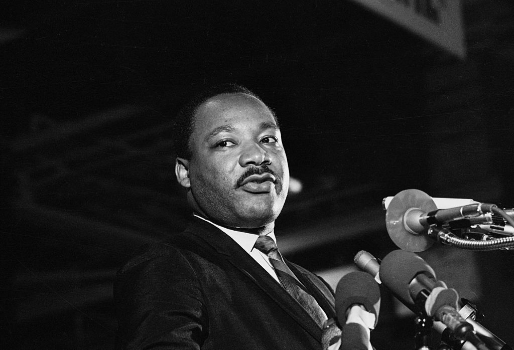 In one of the last pictures taken before his assassination, Dr. Martin Luther King, Jr. speaks to a mass rally on April 3, 1968 in Memphis.