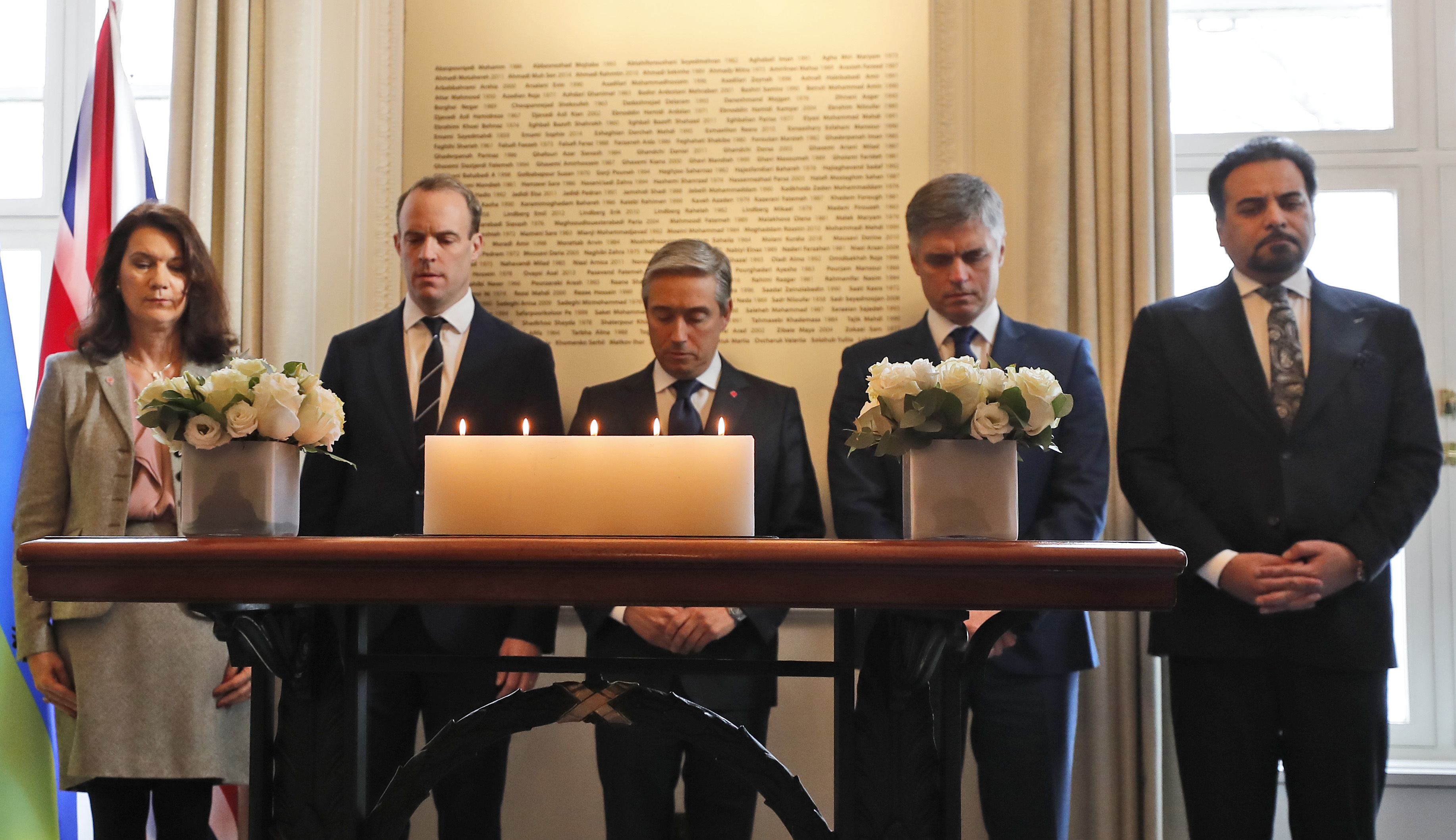 Francois-Philippe Champagne, Canada Minister of Foreign Affairs, centre, Ukraine Minister of Foreign Affairs Vadym Prystaiko, second right, United Kingdoms Secretary of State for Foreign Affairs Dominic Raab, second left, Sweden's Minister of Foreign Affairs Ann Linde, left, and Afghanistan's Foreign Minister Idrees Zaman, hold a minute of silence behind candles and in front of a plaque with the names of the victims of flight PS752, at the High Commission of Canada in London, Thursday, Jan. 16, 2020.