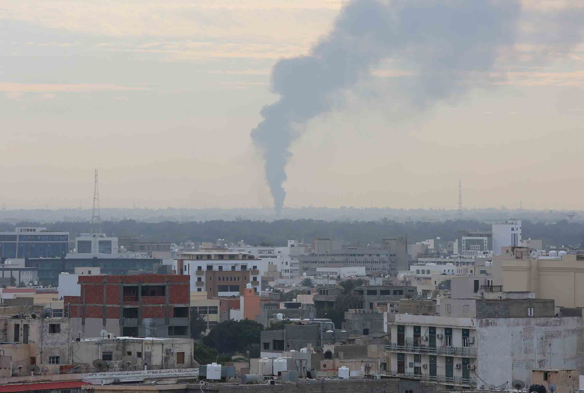 TRIPOLI, LIBYA - JANUARY 19: Smoke rises after forces of Warlord Khalifa Haftar attacked to capital Tripoli, Libya on January 19, 2020. Haftars forces had again violated the cease-fire which started early last Sunday.