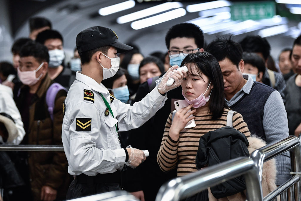 Citizens have their temperatures checked in Guangzhou, China on Jan. 22, 2020.