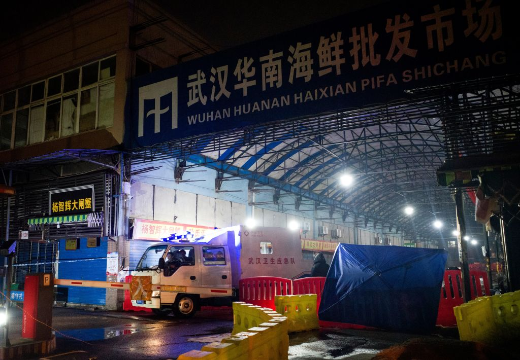 Members of staff of the Wuhan Hygiene Emergency Response Team drive their vehicle as they leave the closed Huanan Seafood Wholesale Market in the city of Wuhan, in Hubei, Province on January 11, 2020, where the Wuhan health commission said that the man who died from a respiratory illness had purchased goods.