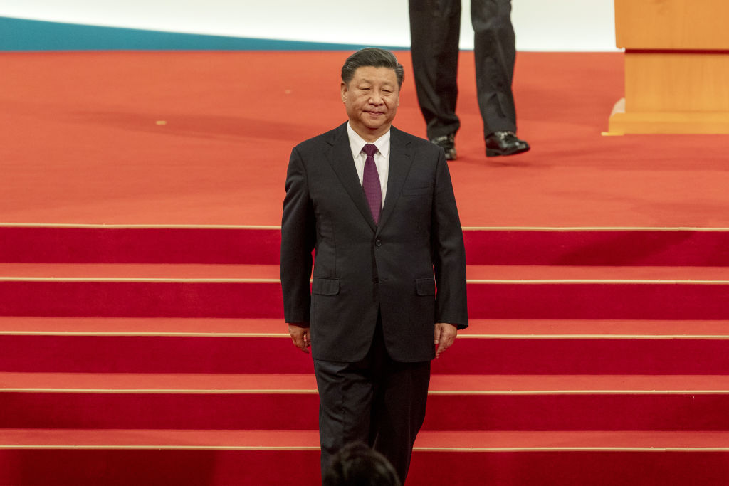 Xi Jinping, China's president, walks off the stage during an inauguration ceremony in Macau, China, on Friday, Dec. 20, 2019. Xi praised the work of Macau's government in maintaining stability on Friday as the former Portuguese colony celebrates the 20-year anniversary of its return to Chinese rule.