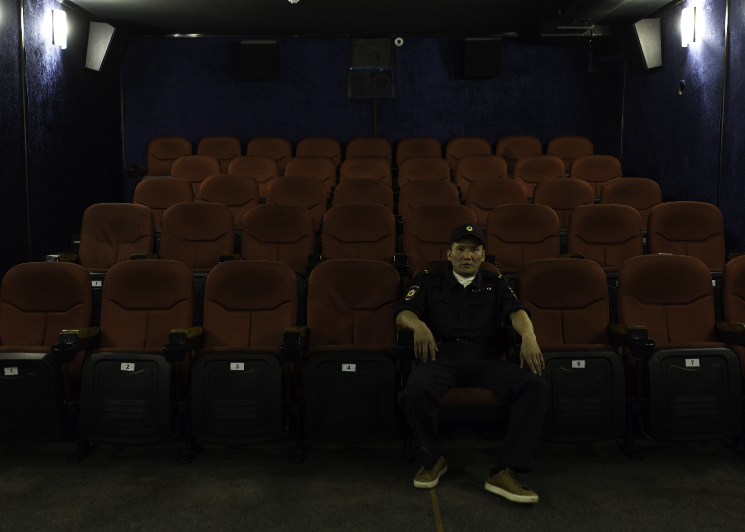 Theater actor Vladimir Okhlopkov, who played the role of a police officer in the horror film 'The Cursed Land' directed by Stepan Burnashev, poses in a small movie theater in Yakutsk, Yakutia in June 2019.