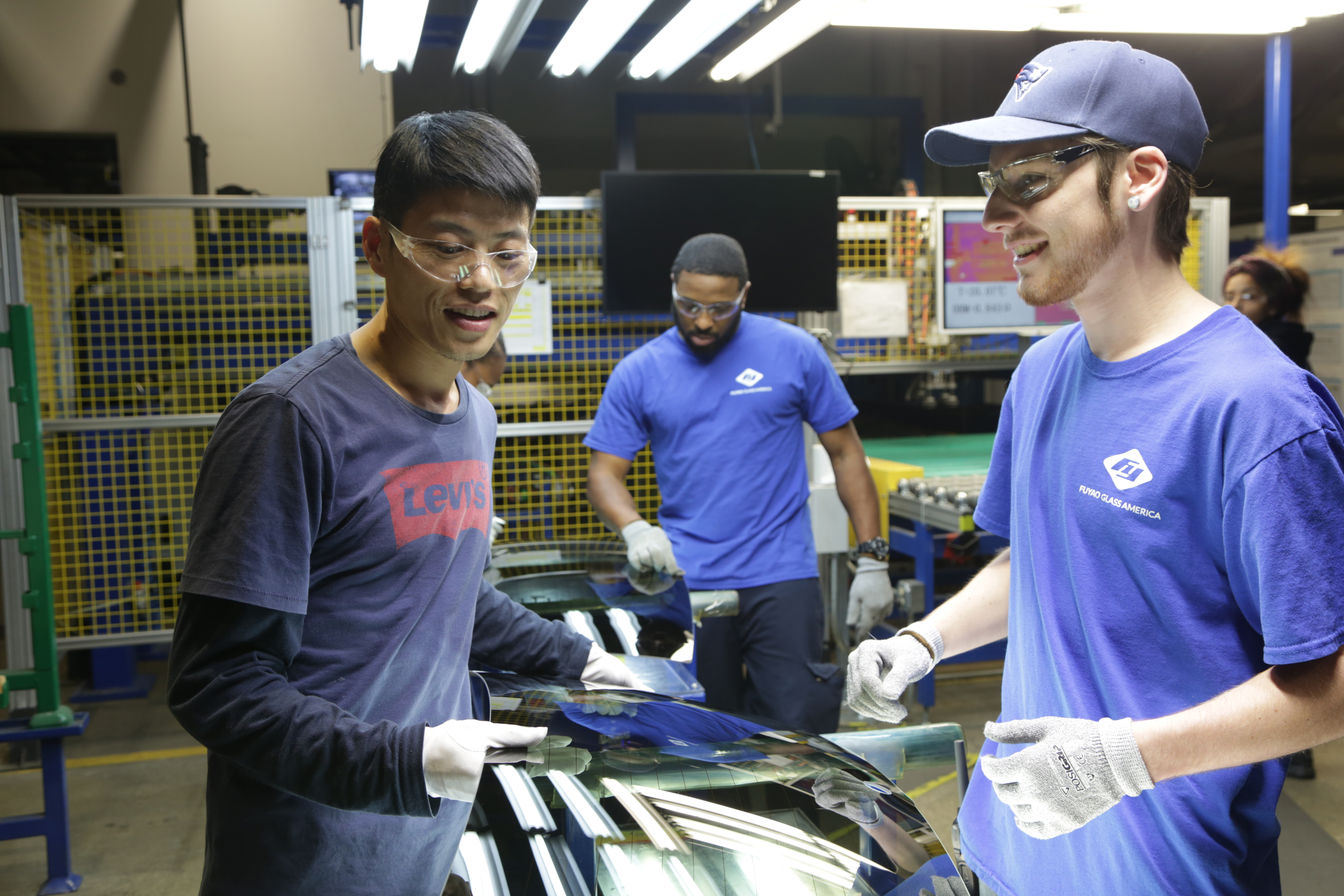 From left, Wong He, Kenny Taylor and Jarred Gibson in  American Factory.