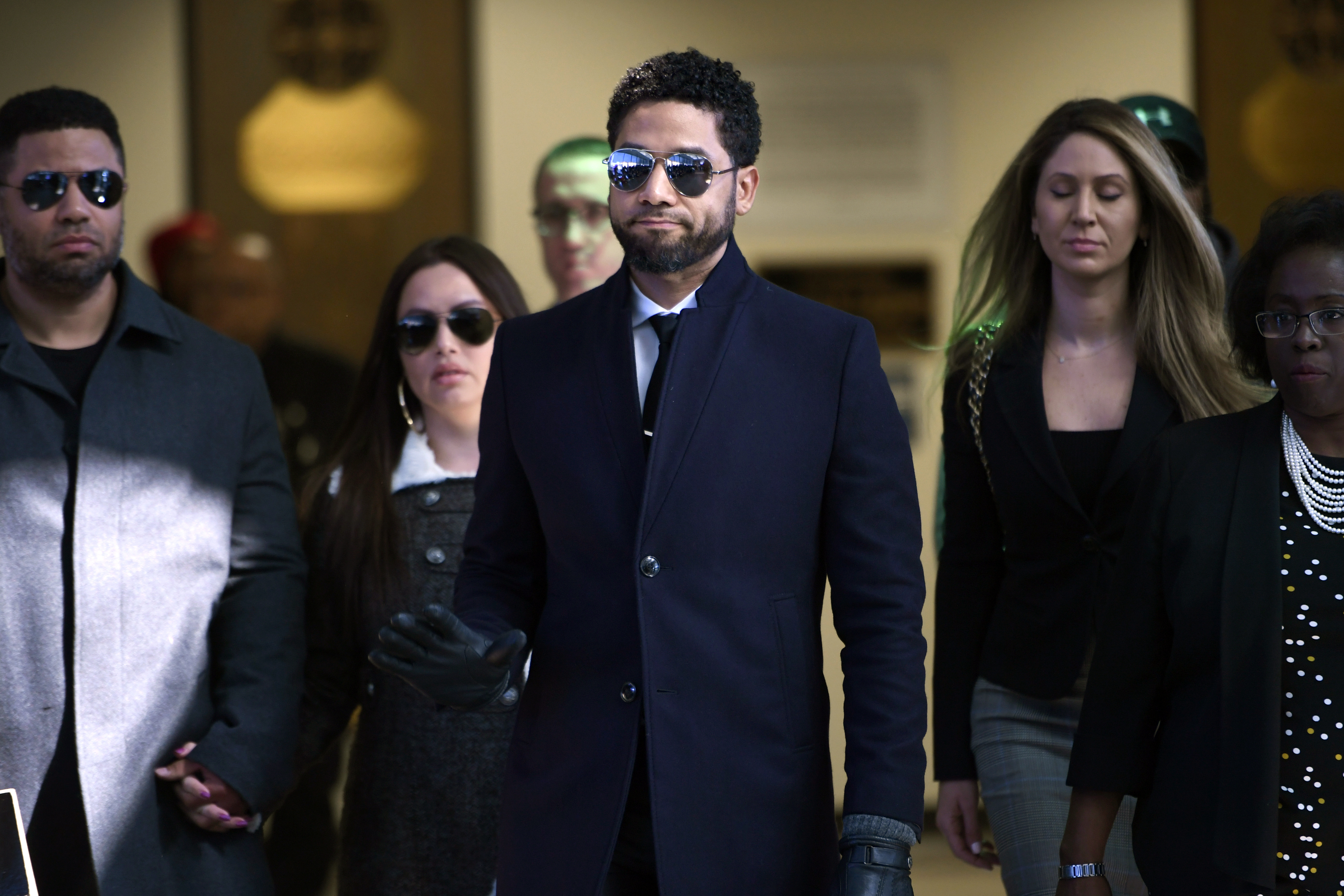 Actor Jussie Smollett gestures as he leaves Cook County Court after his charges were dropped in Chicago on March 26, 2019.