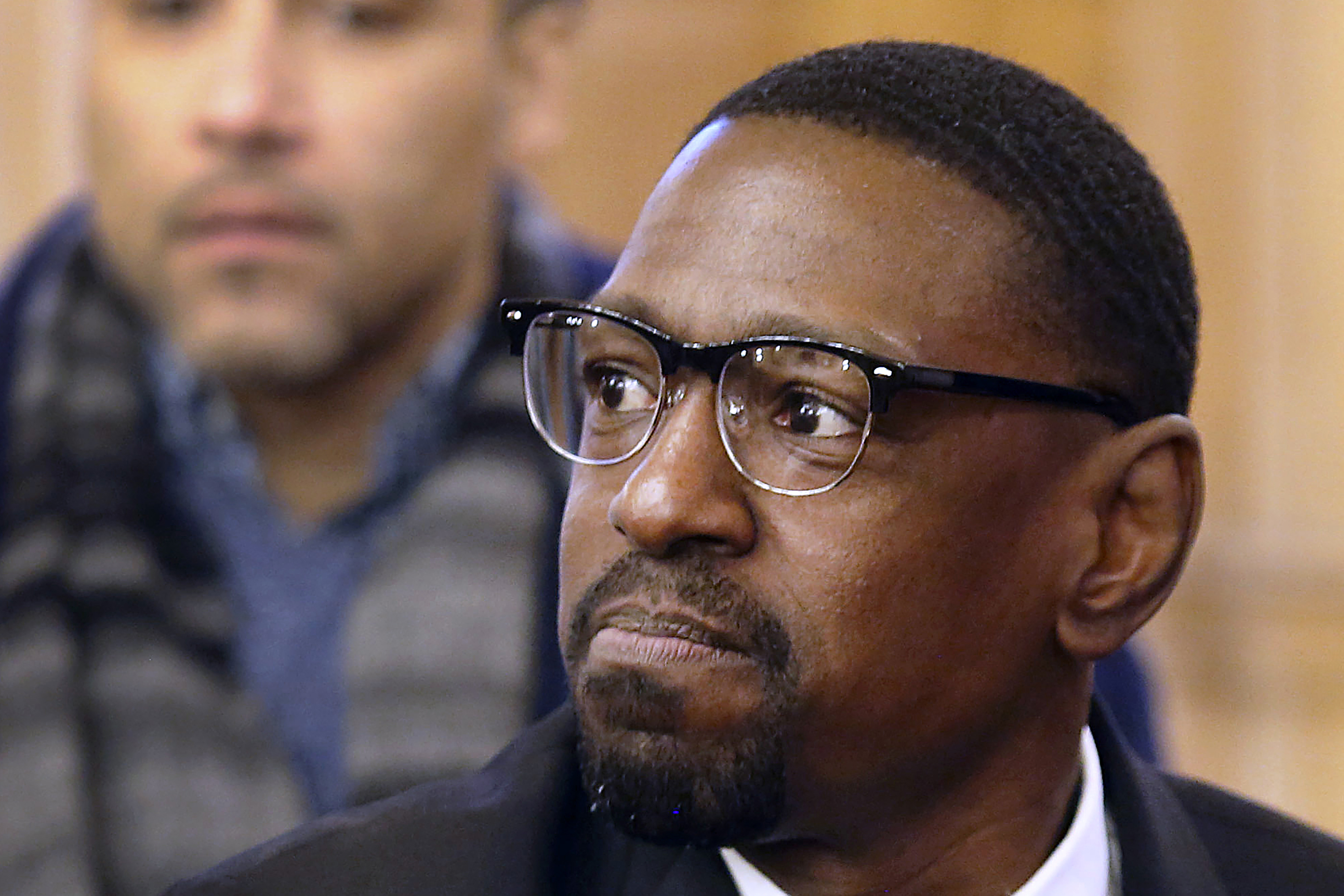 FILE - In this Feb. 14, 2018 file photo, Lamonte McIntyre, convicted of a 1994 double homicide in Kansas City, Kan., sits before the Senate Judiciary Committee in Topika Kan. McIntyre, who spent 23 years in prison for a double murder he did not commit was granted more than $1.5 million in compensation under the state's mistaken-conviction statute.