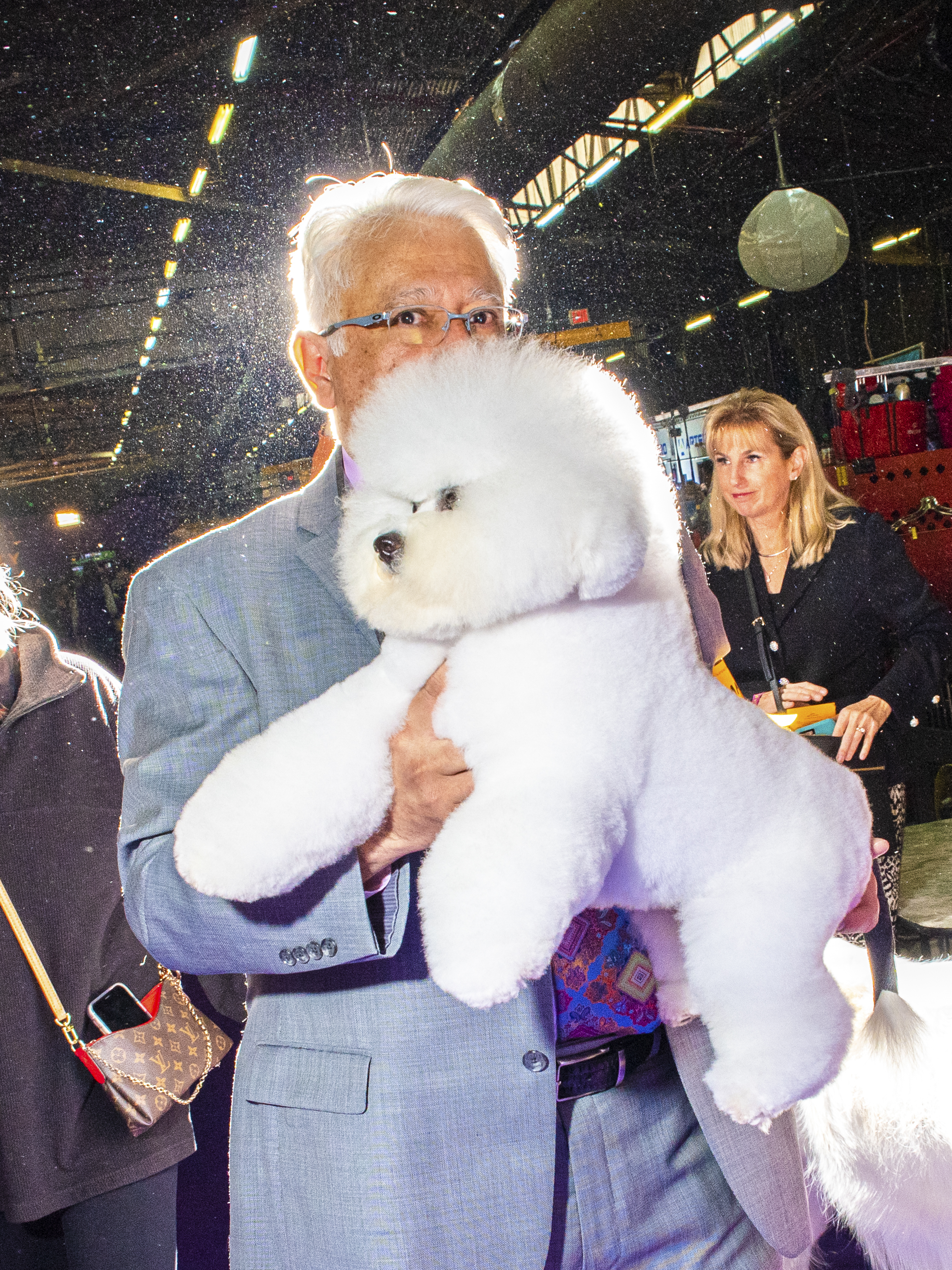 A Bichon Frise and their handler Paul Flores at the Westminster Dog Show in New York City on Feb. 10, 2020.