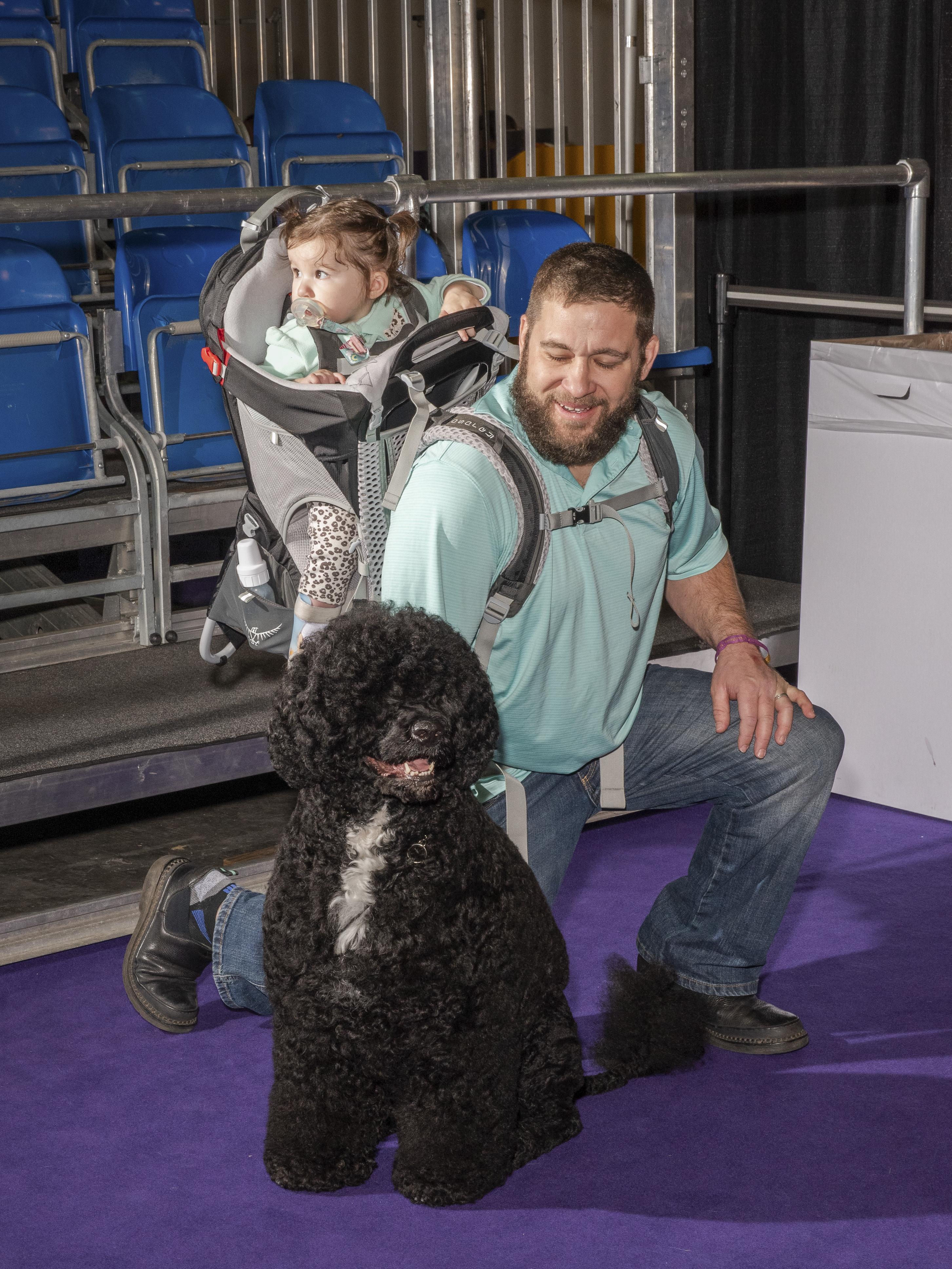 Mike Medina poses with his daughter and Portugese Water Dog on Feb. 11, 2020.
