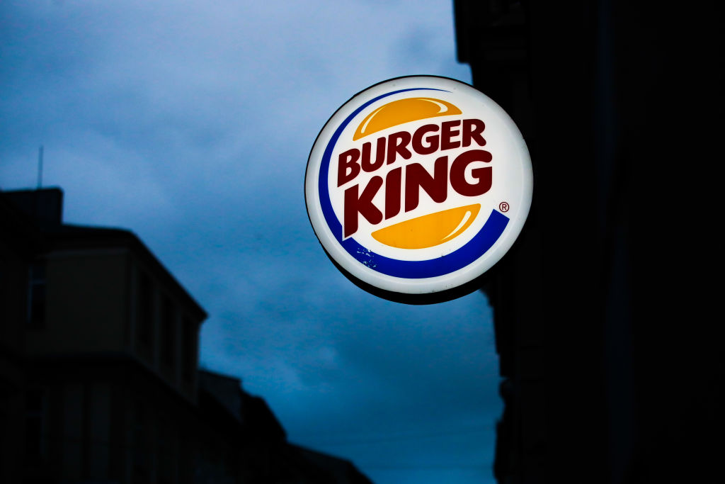 In this photo illustration, Burger King logo is seen near restaurant in Krakow, Poland on December 29, 2019.