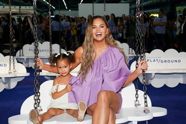 Luna Stephens and Chrissy Teigen pose for a photo during POPSUGAR Play/Ground at Pier 94 in New York, N.Y., on June 23, 2019.