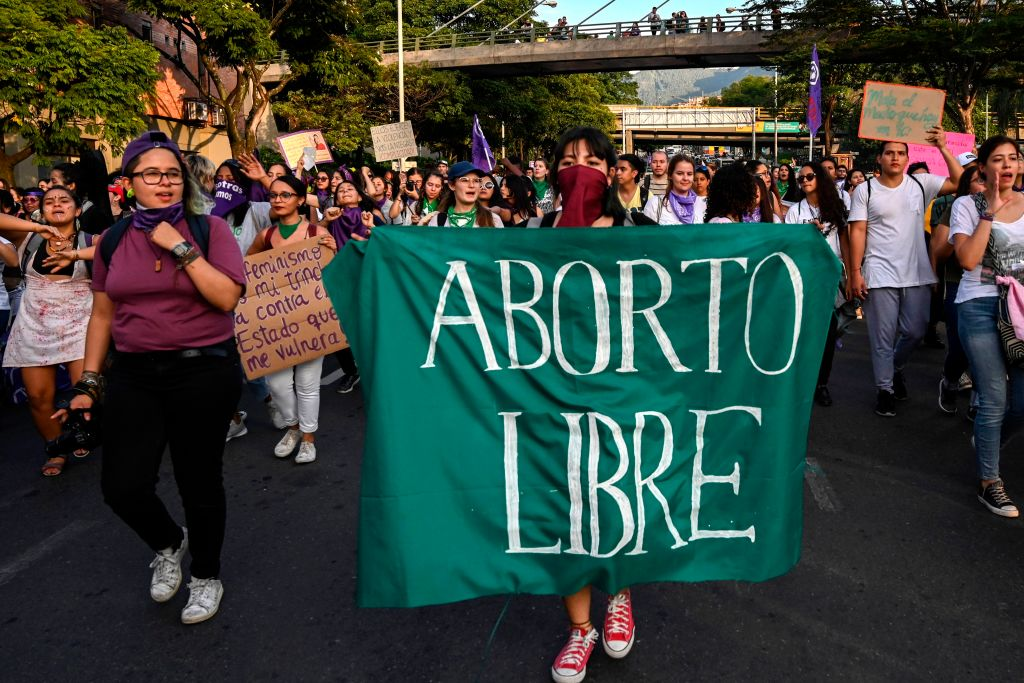 Women march with a banner reading  Free abortion  during the International Day for the Elimination of Violence Against Women in Medellin, Colombia, on November 25, 2019.