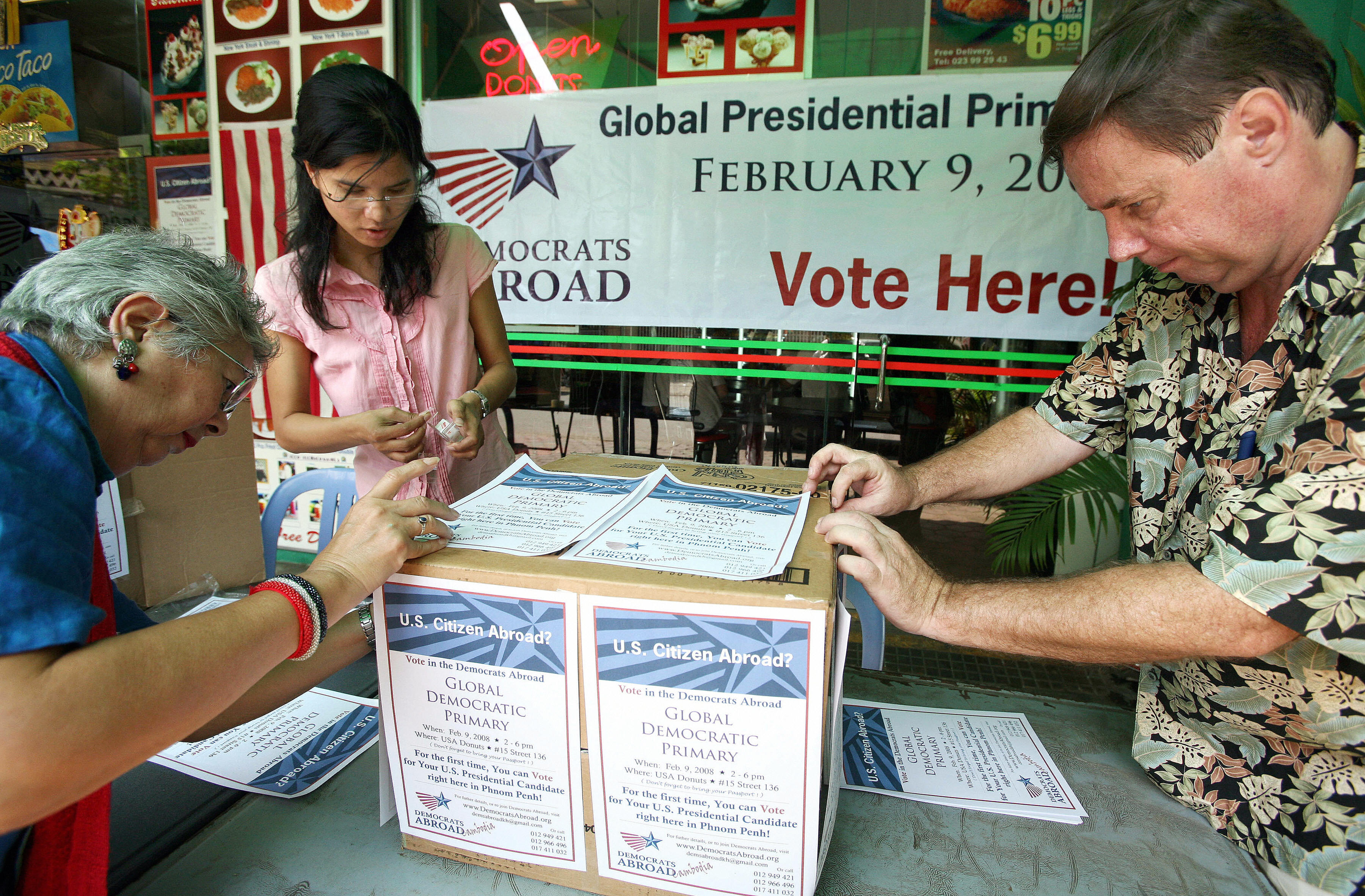 Members of the organization Democrats Abroad in Cambodia create a makeshift voting booth for the US Democratic Party primary on Feb. 6, 2008.
