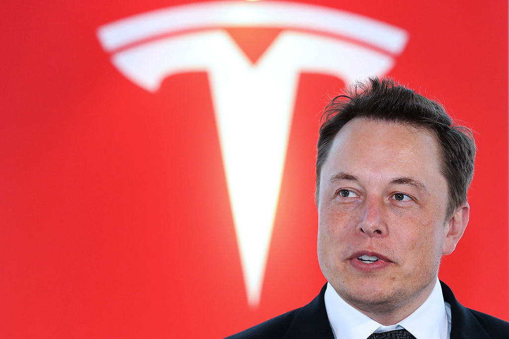 Elon Musk, co-founder and chief executive officer of Tesla Motors Inc., attends a key delivery ceremony of the company's premium electric sedan Model S vehicles to customers in Tokyo, Japan, on Sept. 8, 2014.