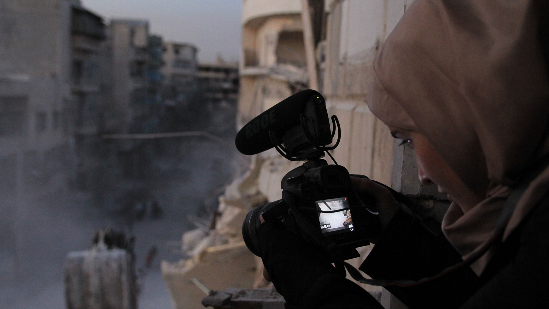 Waad al-Kateab filming the ruins of a building destroyed by bombing in besieged east Aleppo, October 2016