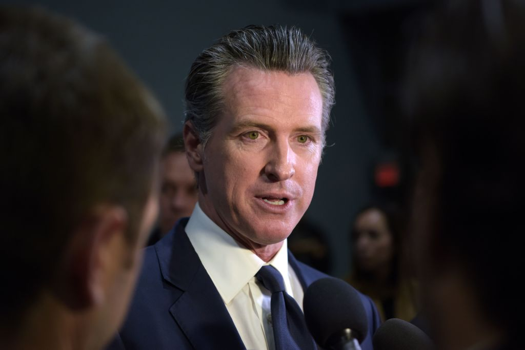 California Governor Gavin Newsom speaks to the press in the spin room after the sixth Democratic primary debate of the 2020 presidential campaign season co-hosted by PBS NewsHour & Politico at Loyola Marymount University in Los Angeles, Calif., on Dec. 19, 2019.