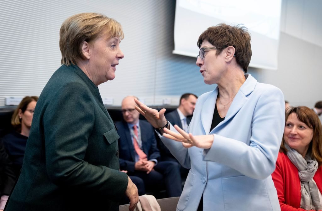 Chancellor Angela Merkel and Annegret Kramp-Karrenbauer (r, CDU), Federal Minister of Defence and CDU Federal Chairwoman, are talking at the beginning of the session of the CDU/CSU parliamentary group in the German Bundestag. Getty—Kay Nietfeld