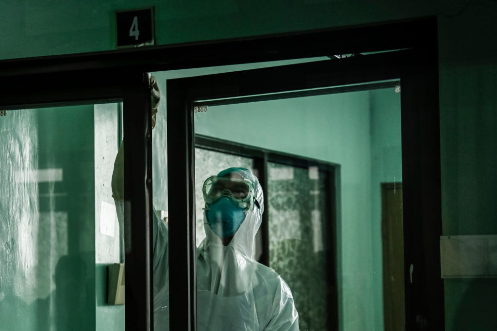 Health worker wearing protective gear prepare for observation during exercise in handling suspected coronavirus patient inside isolation ward in Sanglah General Hospital, Denpasar, Bali, Indonesia on February 12 2020.