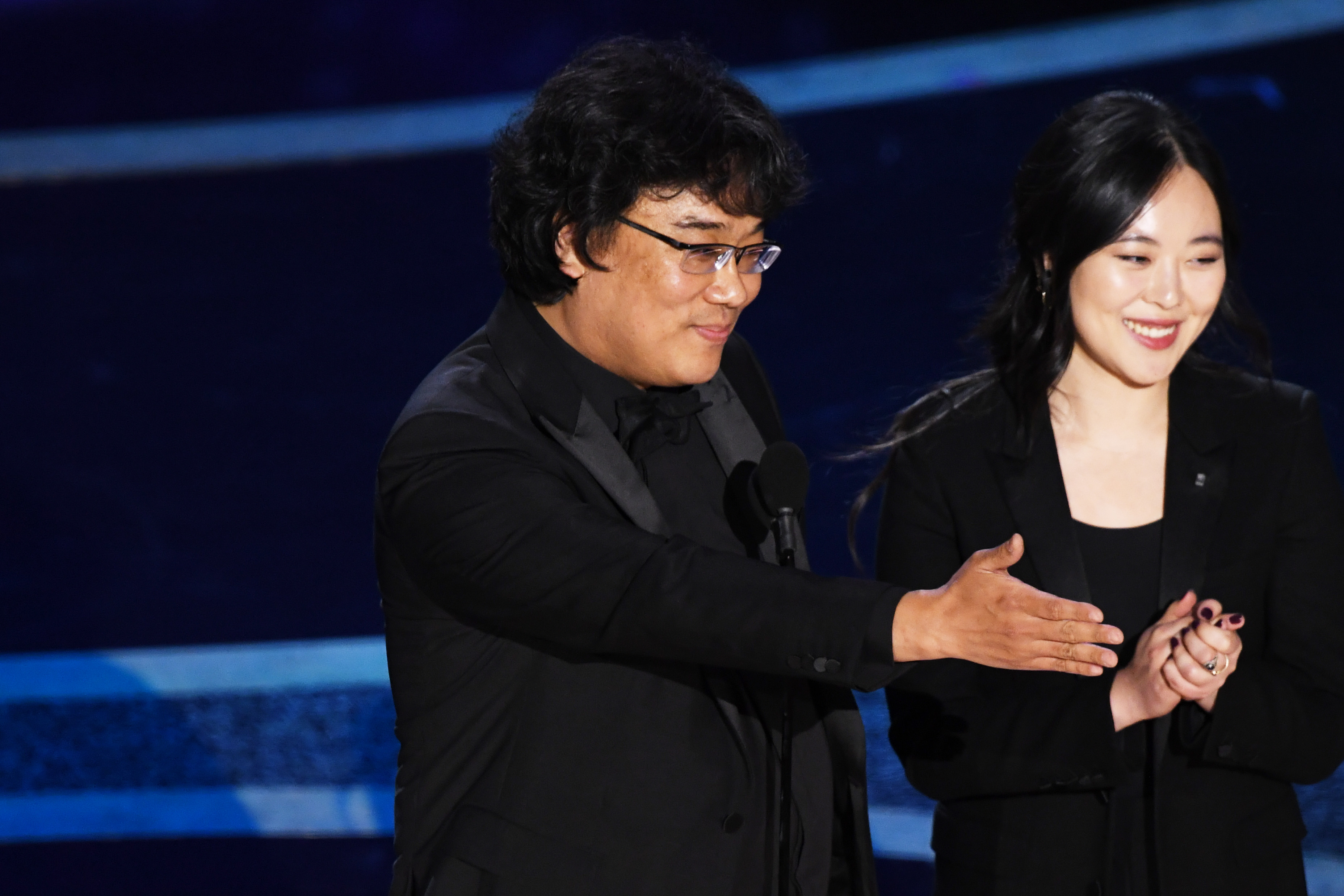 Bong Joon-ho accepts the Directing award for 'Parasite' with interpreter Sharon Choi onstage during the 92nd Annual Academy Awards on February 09, 2020 in Hollywood, California.