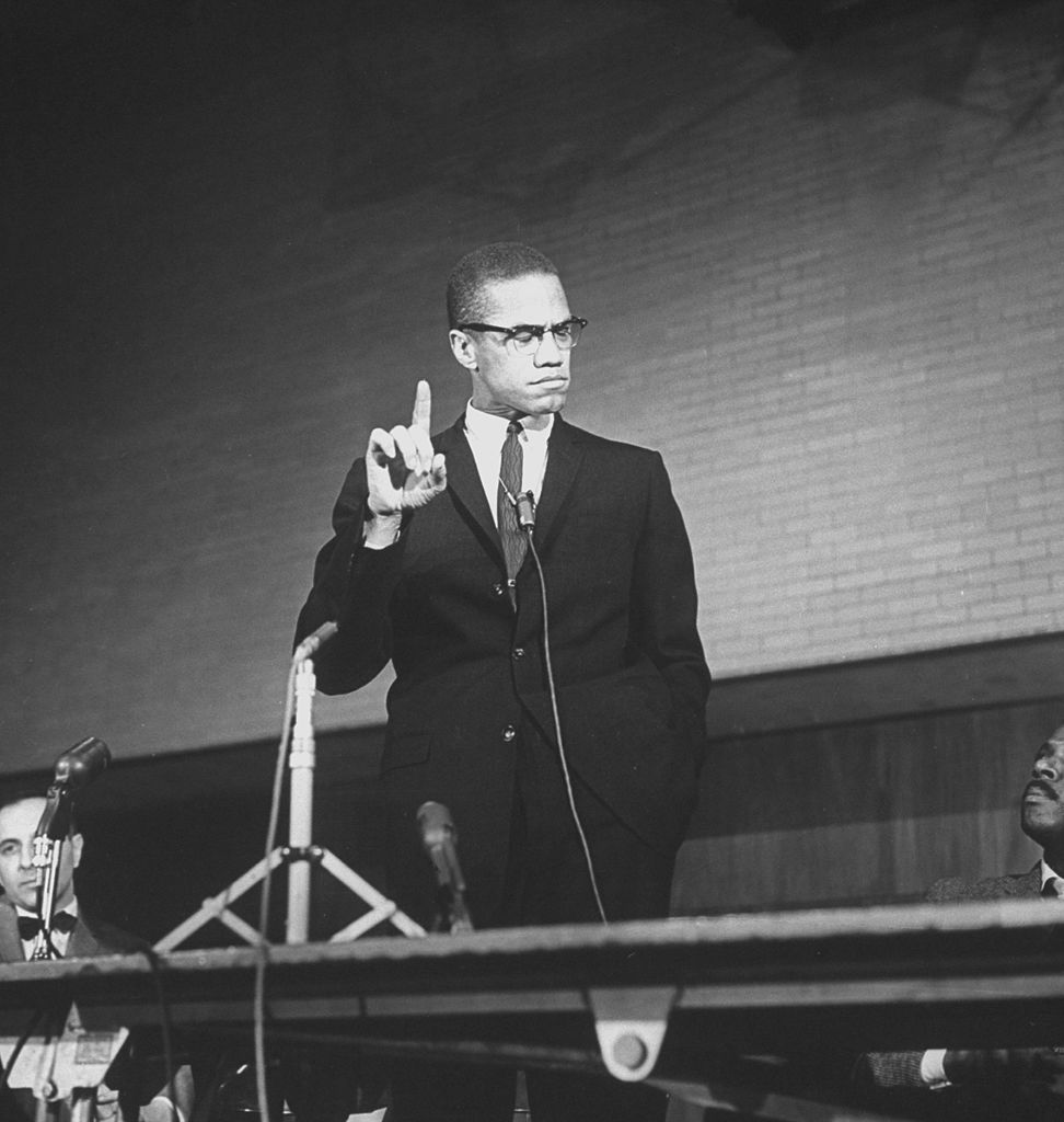 Malcolm X during a speech at a rally as others look on. It's been 55 years since Malcolm X was assassinated while speaking at the Audubon Ballroom in Harlem, New York on Feb. 21, 1965.