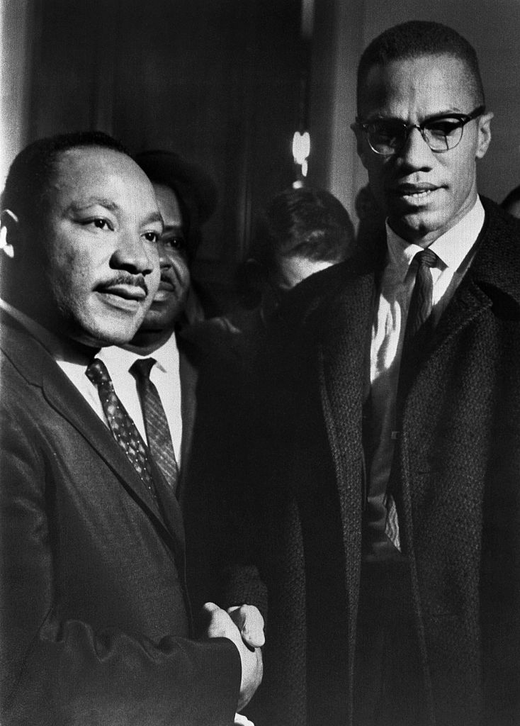 The brief, and only, meeting between Malcolm X and Martin Luther King, in the halls of the U.S. Capitol, observing a Senate filibuster on the Voting Rights Act.