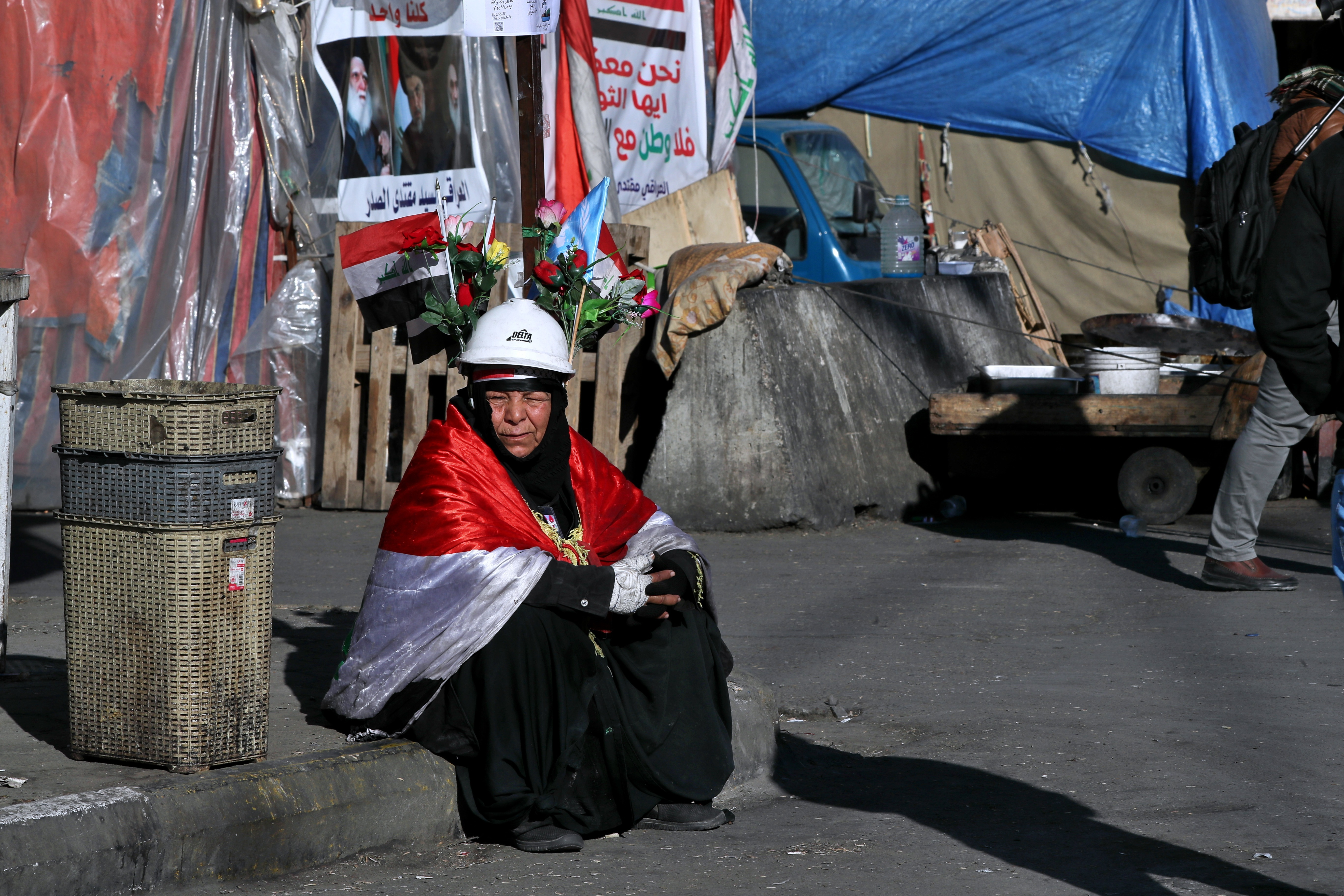 A woman takes part in the ongoing anti-government protests in Tahrir Square, Baghdad, Iraq, on Feb. 1, 2020.