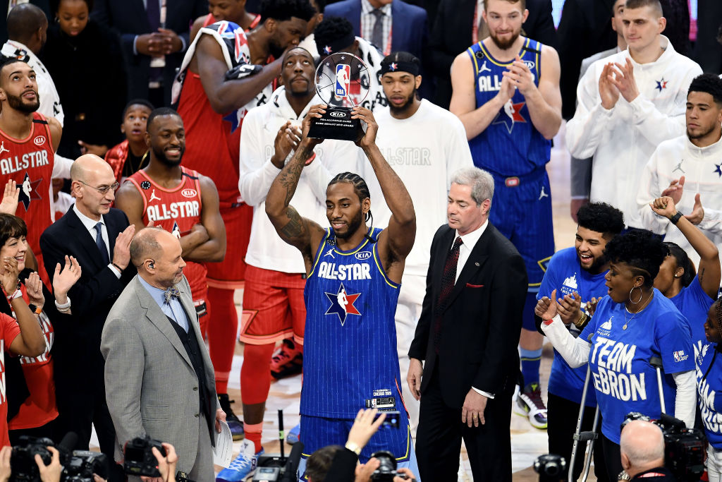 Kawhi Leonard of Team LeBron celebrates with the trophy after being named the Kobe Bryant MVP during the 69th NBA All-Star Game at the United Center on Feb. 16, 2020 in Chicago, Ill.