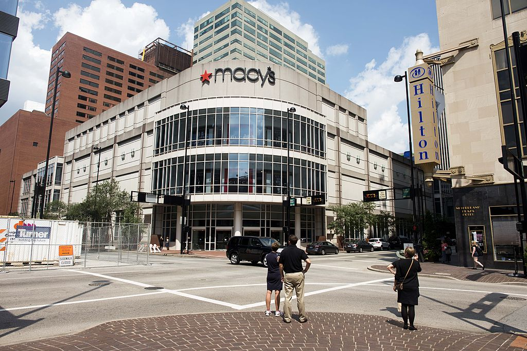 Macy's is closing 125 stores and its corporate offices in Cincinnati, Ohio, as it works to restructure amid the digital retail economy. Pictured, the Macy's in downtown Cincinnati.