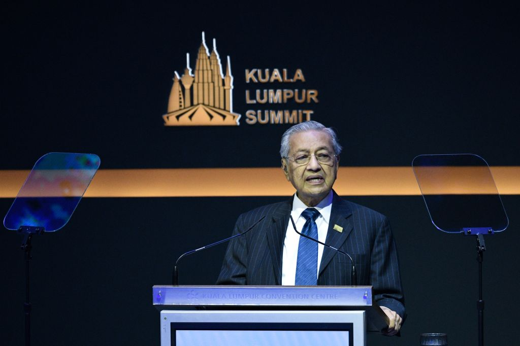 Malaysian Prime Minister Mahathir Mohamad, pictured at a summit on Dec. 19, 2019, has submitted his resignation to Malaysia's king.