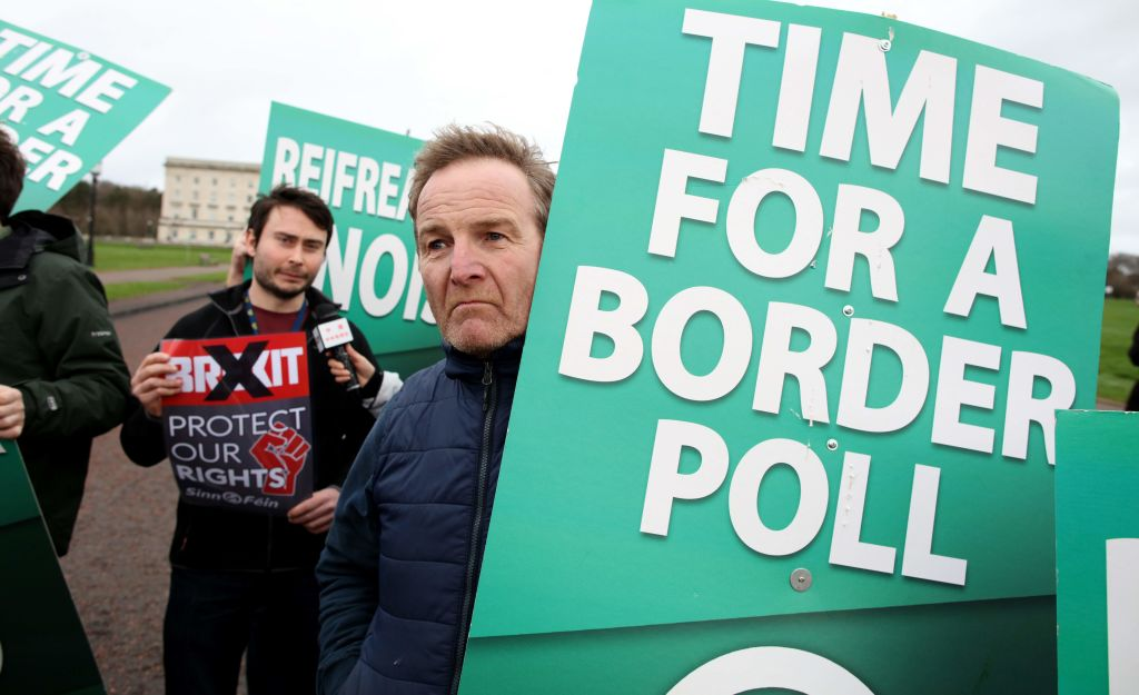 Sinn Fein activists protest at the Parliament Buildings on the Stormont Estate in Belfast on January 31, 2020 against Brexit and call for a border poll on Irish Unity.