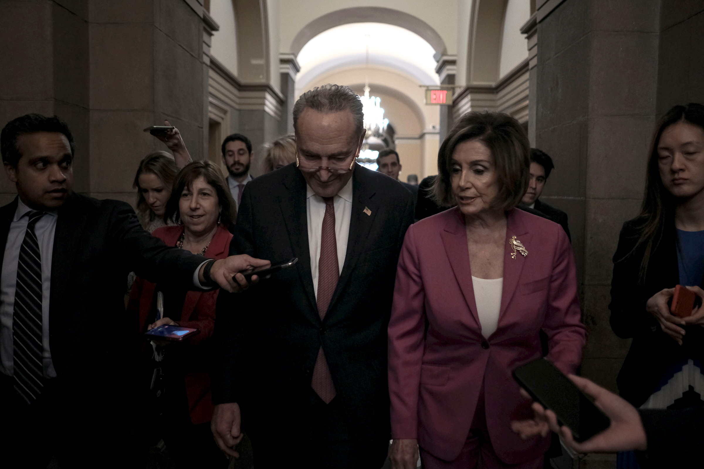 Senate Minority Leader Chuck Schumer and Speaker Nancy Pelosi leave a press conference on lowering the price for healthcare in anticipation to President Trump's State of the Union address at the Capitol in Washington, D.C., Feb. 4, 2020.