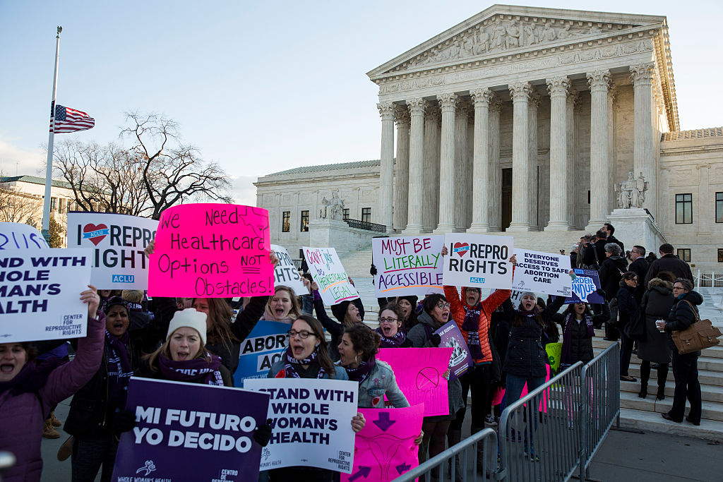 Pro-choice advocates rally outside of the Supreme Court on March 2, 2016 in Washington, DC.
