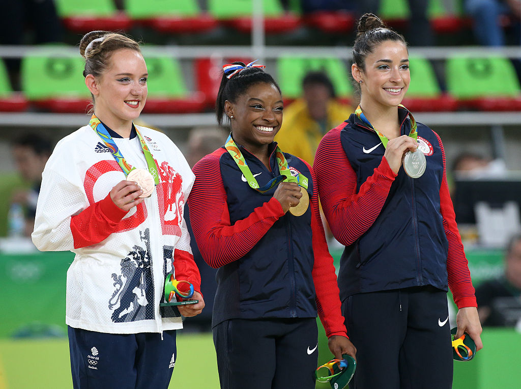 Bronze medalist Amy Tinkler of Great Britain, gold medalist Simone Biles of USA, silver medalist Alexandra Raisman of USA pose during the medal ceremony for the Women's Floor Exercise on day 11 of the Rio 2016 Olympic Games at Rio Olympic Arena on August 16, 2016 in Rio de Janeiro, Brazil.