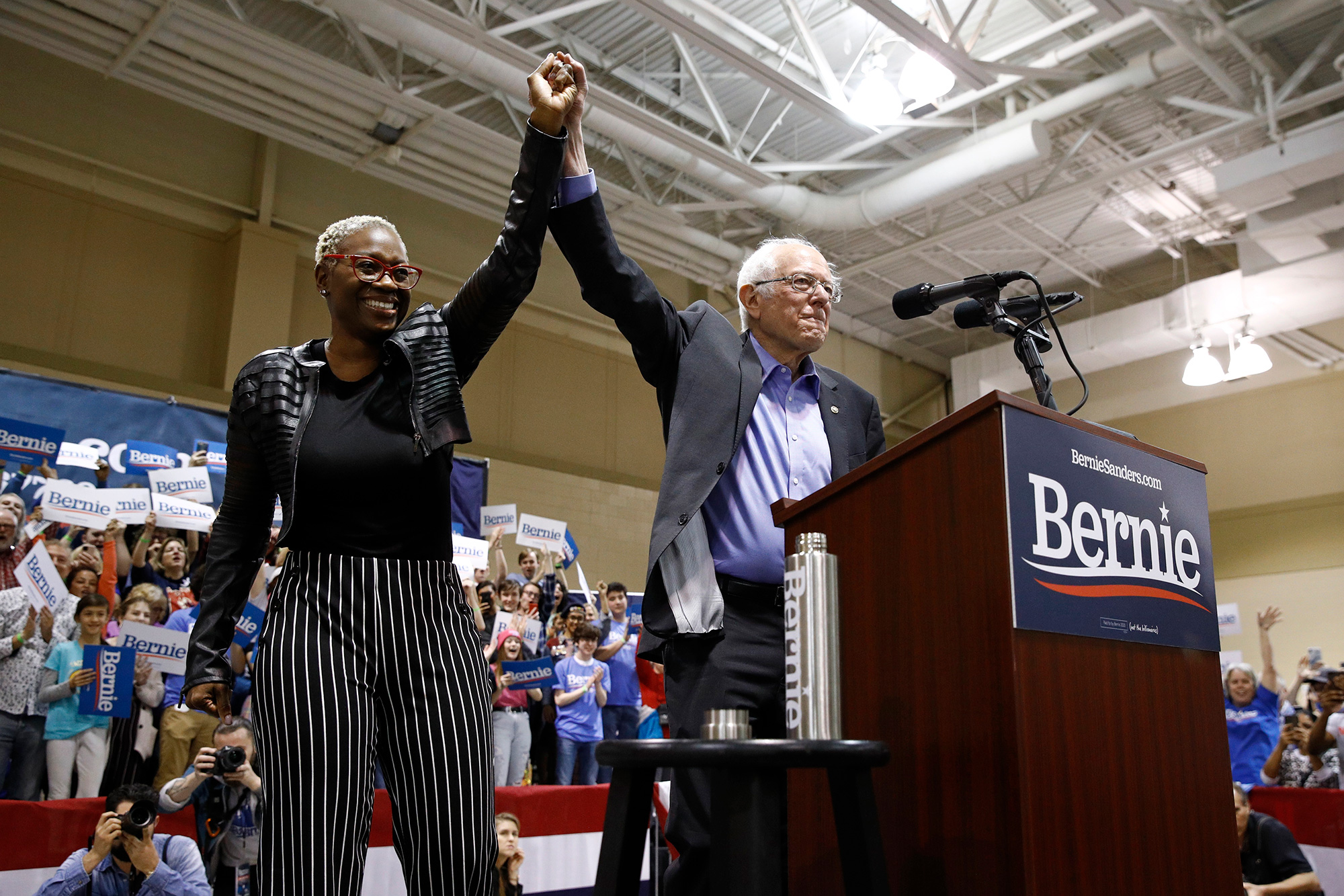 Democratic presidential candidate Sen. Bernie Sanders, right, stands onstage with former Ohio state Sen. Nina Turner before speaking at a campaign event in North Charleston, SC, Feb. 26, 2020.