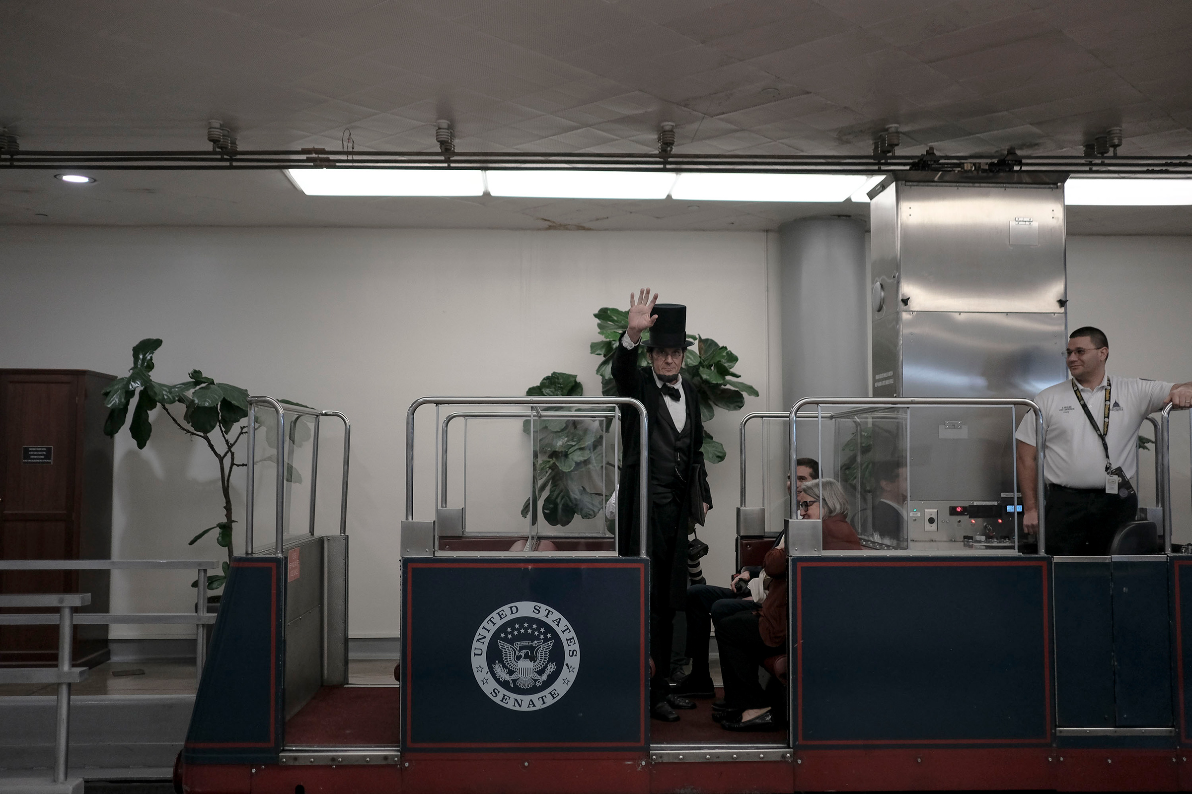 George Buss, a Lincoln impersonator, rides the Senate subway before the impeachment vote at the Capitol in Washington, D.C., on Feb. 5, 2020.