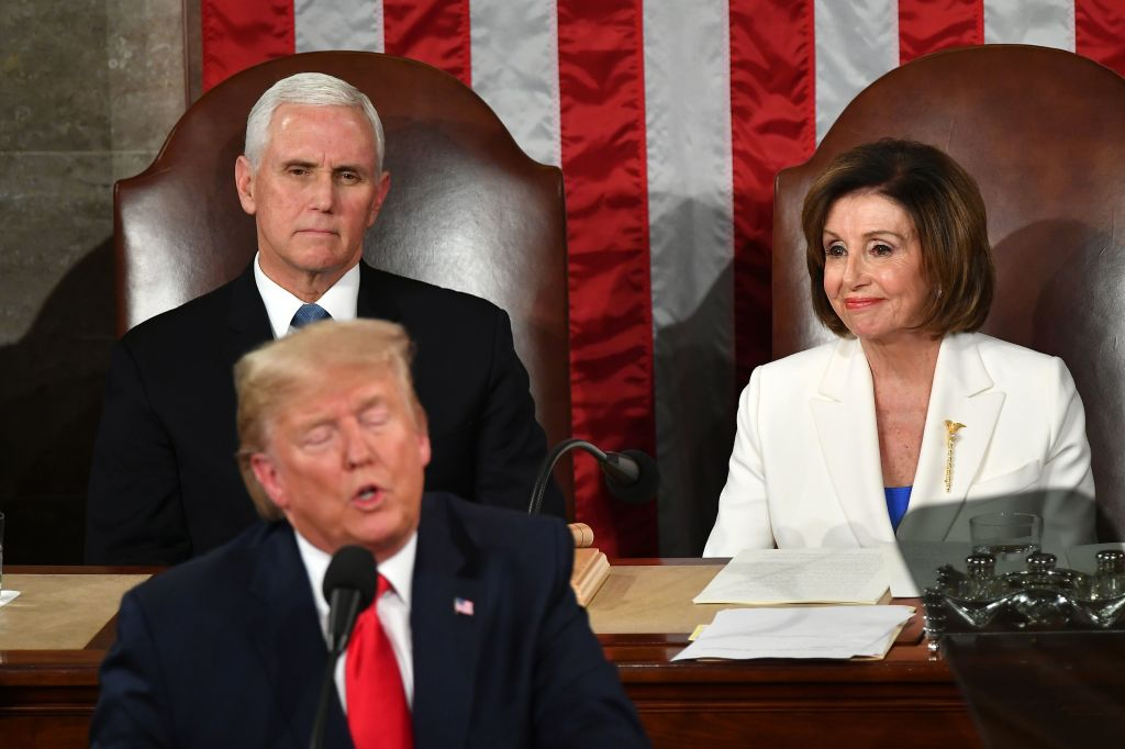 US President Donald Trump delivers the State of the Union address flanked by US Vice President Mike Pence (L) and Speaker of the US House of Representatives Nancy Pelosi (R) at the US Capitol in Washington, DC, on Feb. 4, 2020.