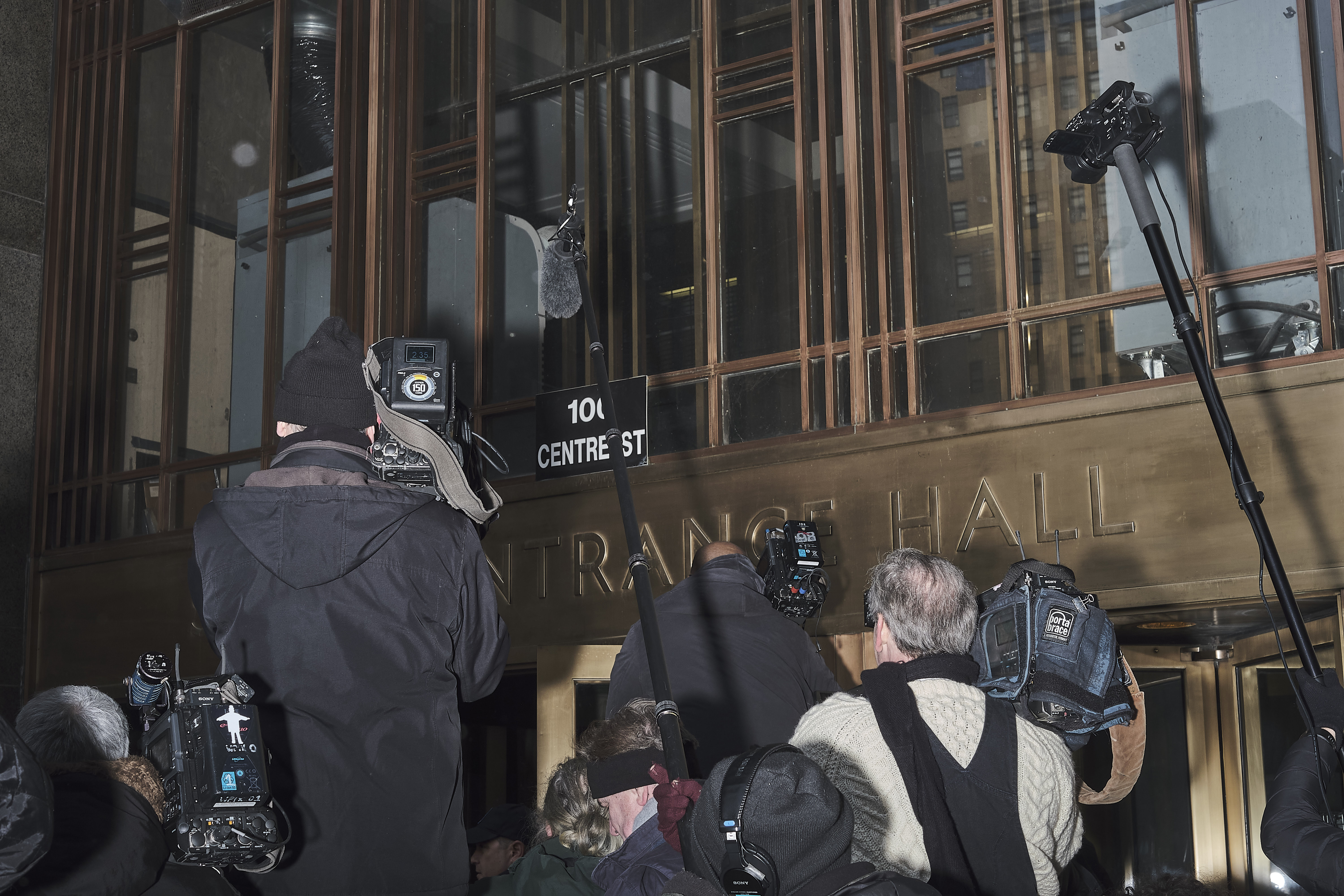 Journalists wait for Weinstein outside the New York City Criminal Court on Jan. 23