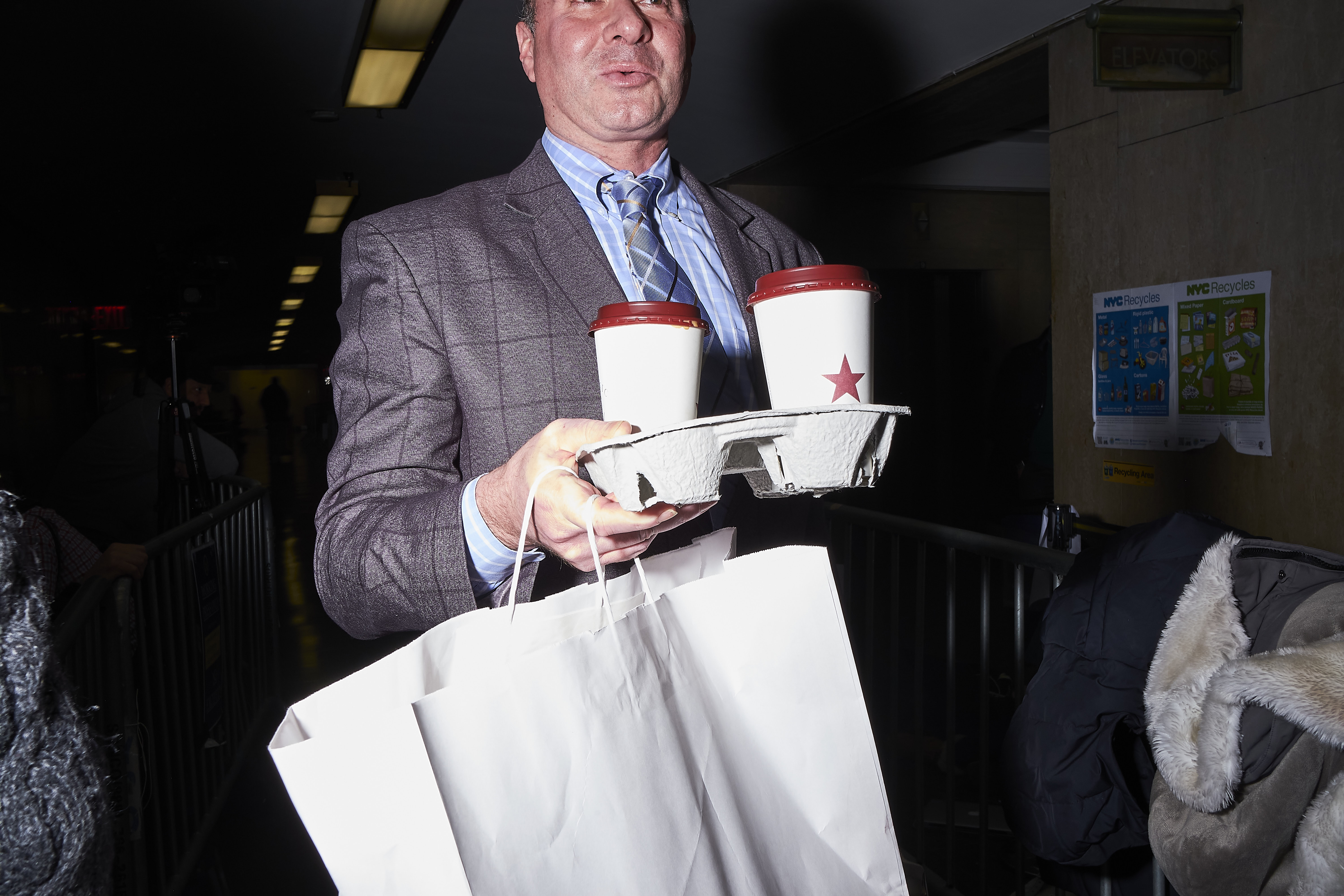 A member of Weinstein's legal team delivers lunch to his client in the courtroom on Jan. 22
