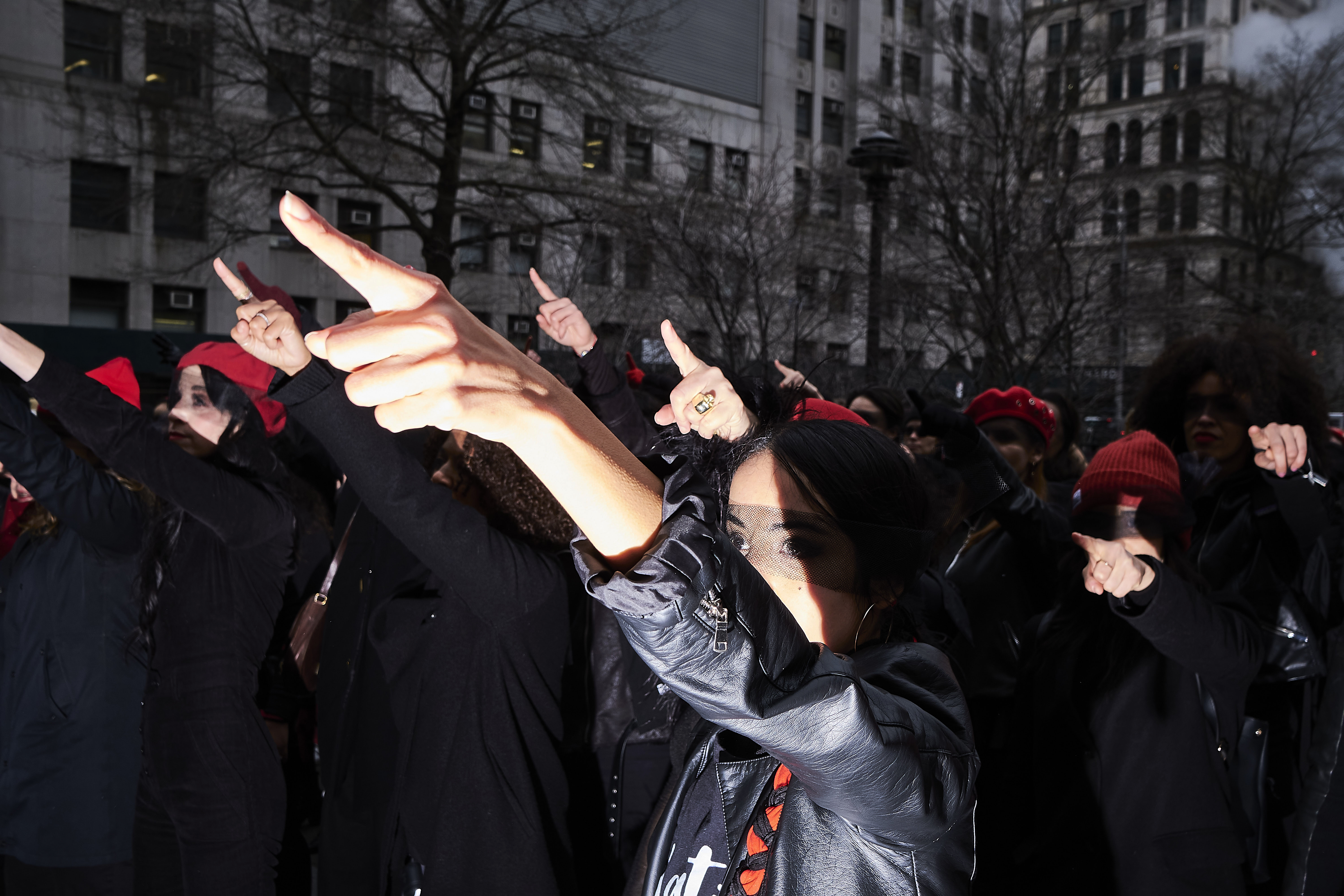 Women inspired by the Chilean feminist group Las Tesis perform  the rape dance  in front of the New York City Criminal Court during Weinstein's rape trial on Jan. 10