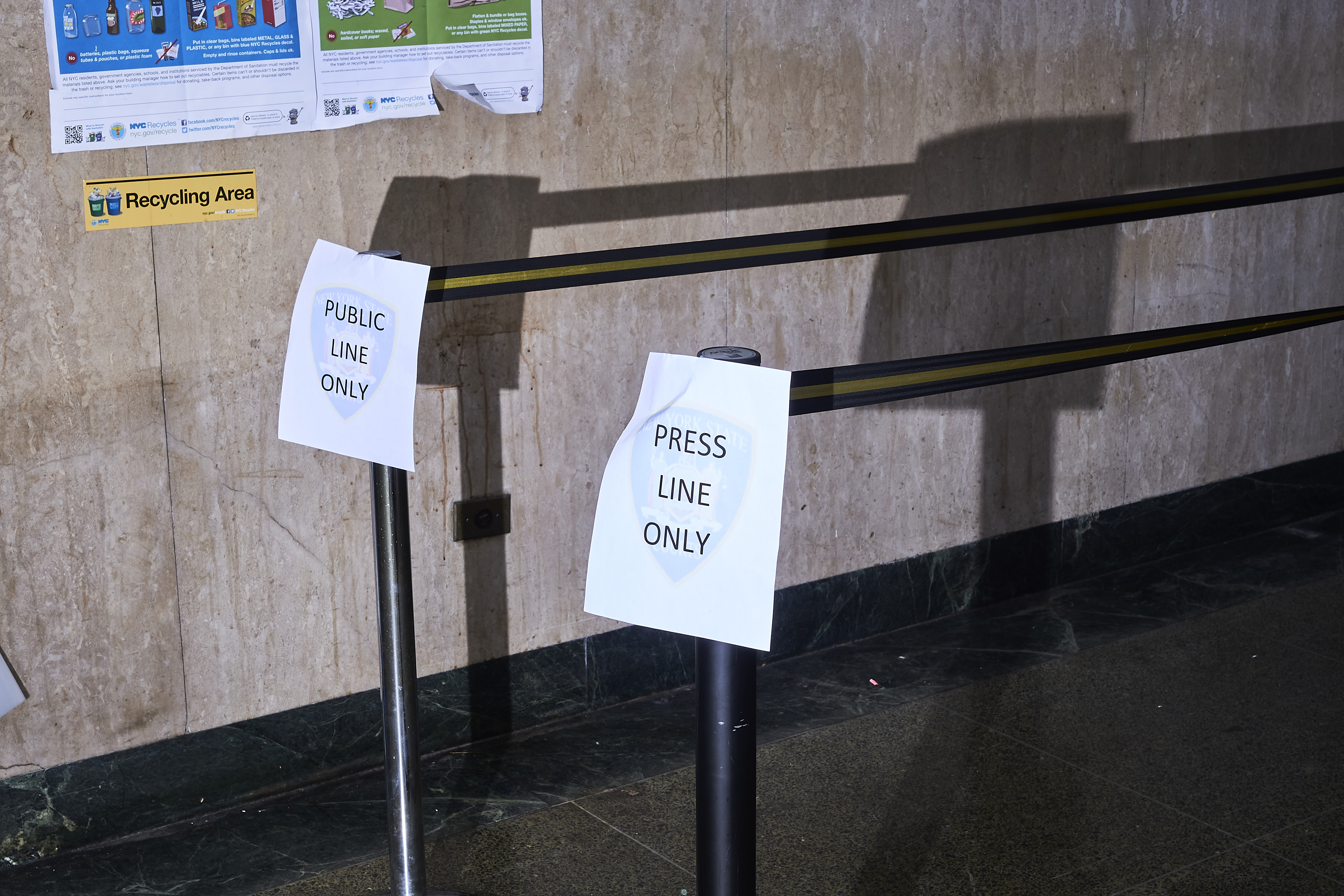 Signs in the New York City Criminal Court hallway designate public and press lines on Jan. 8