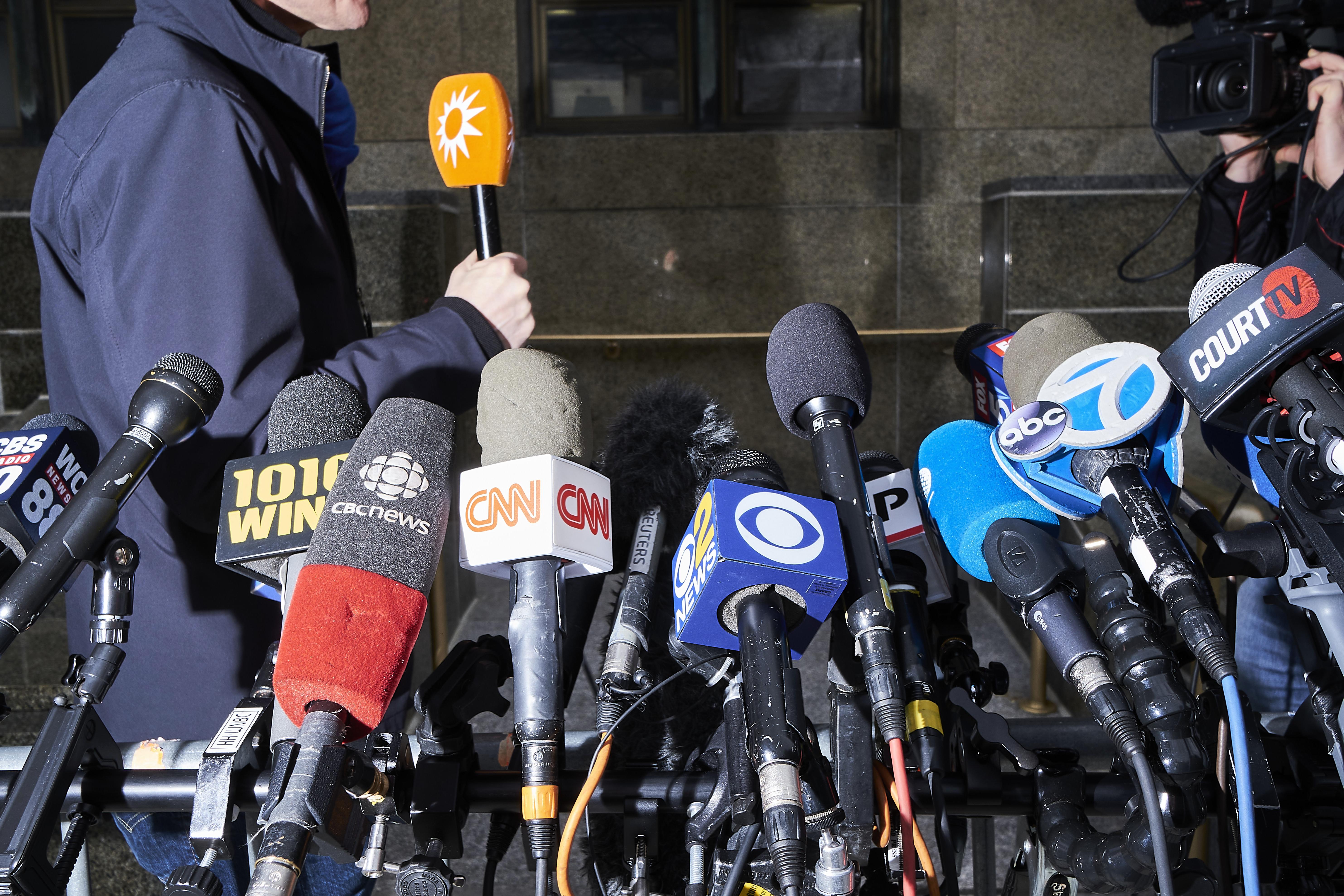 Media microphones outside New York City Criminal Court on Jan. 7