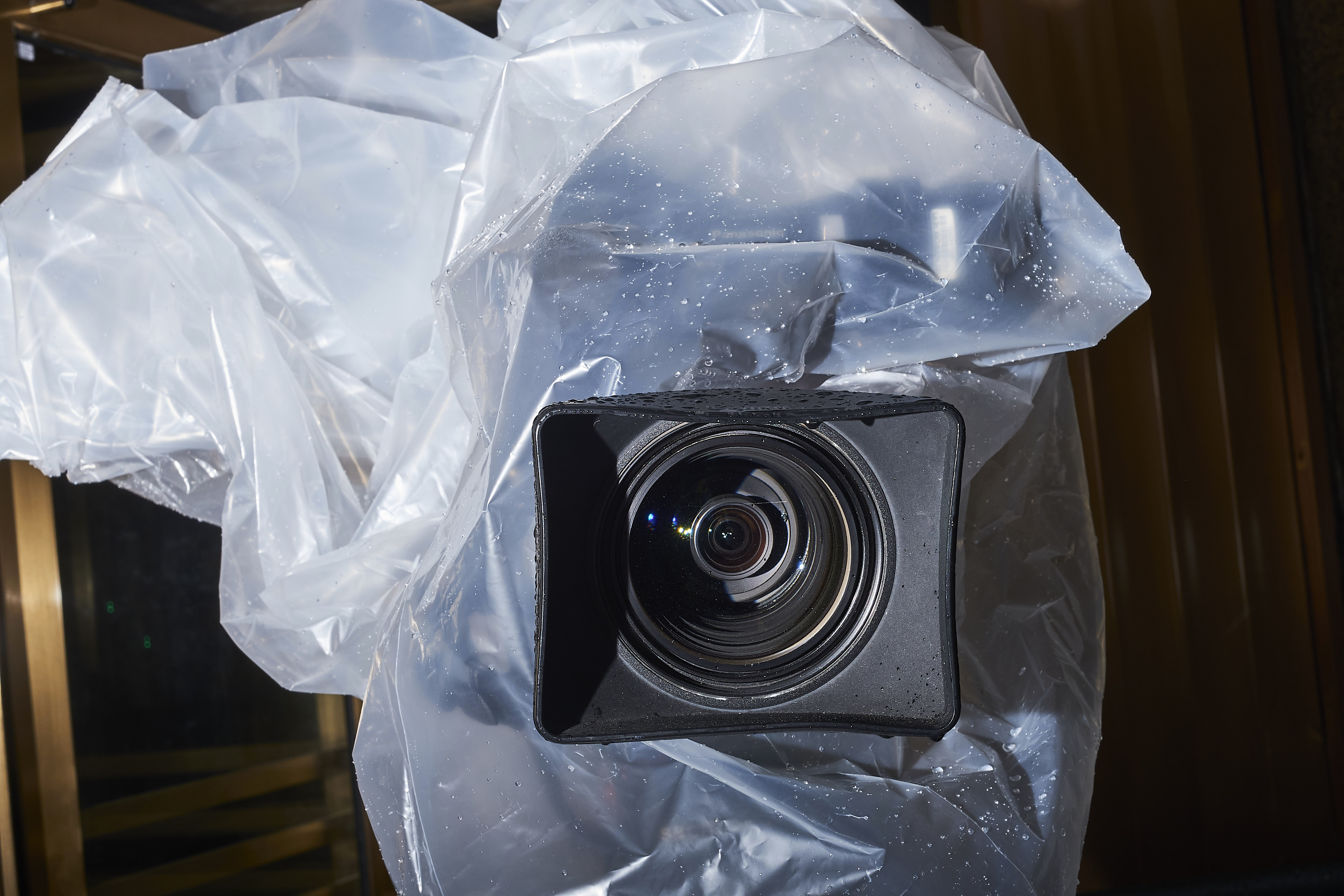 A television camera is protected from rain outside the New York City Criminal Court, Jan. 16