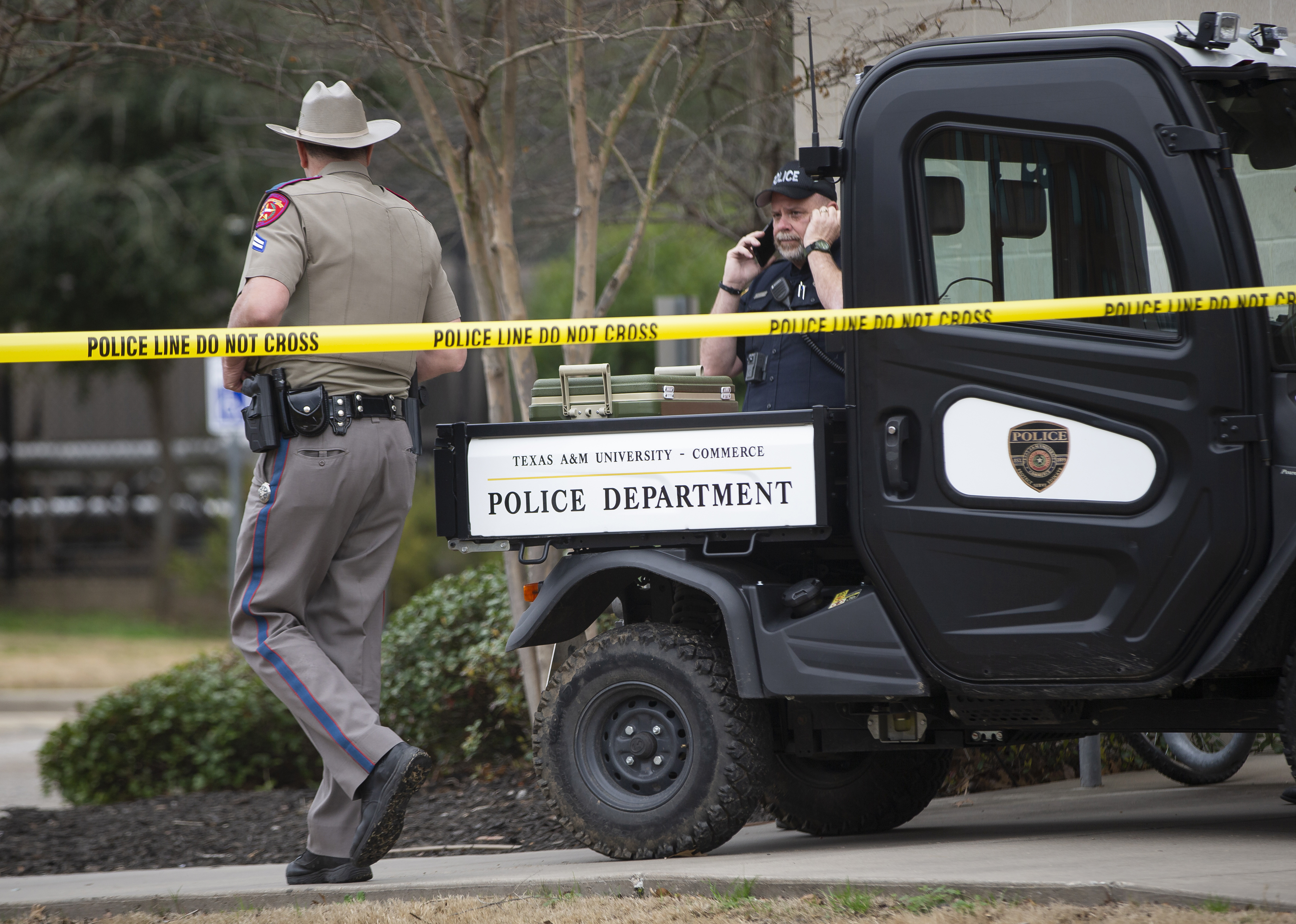 Law enforcement officers work the scene a shooting outside of the Pride Rock residence at Texas A&M University-Commerce in Commerce, Texas, Monday, Feb. 3, 2020.