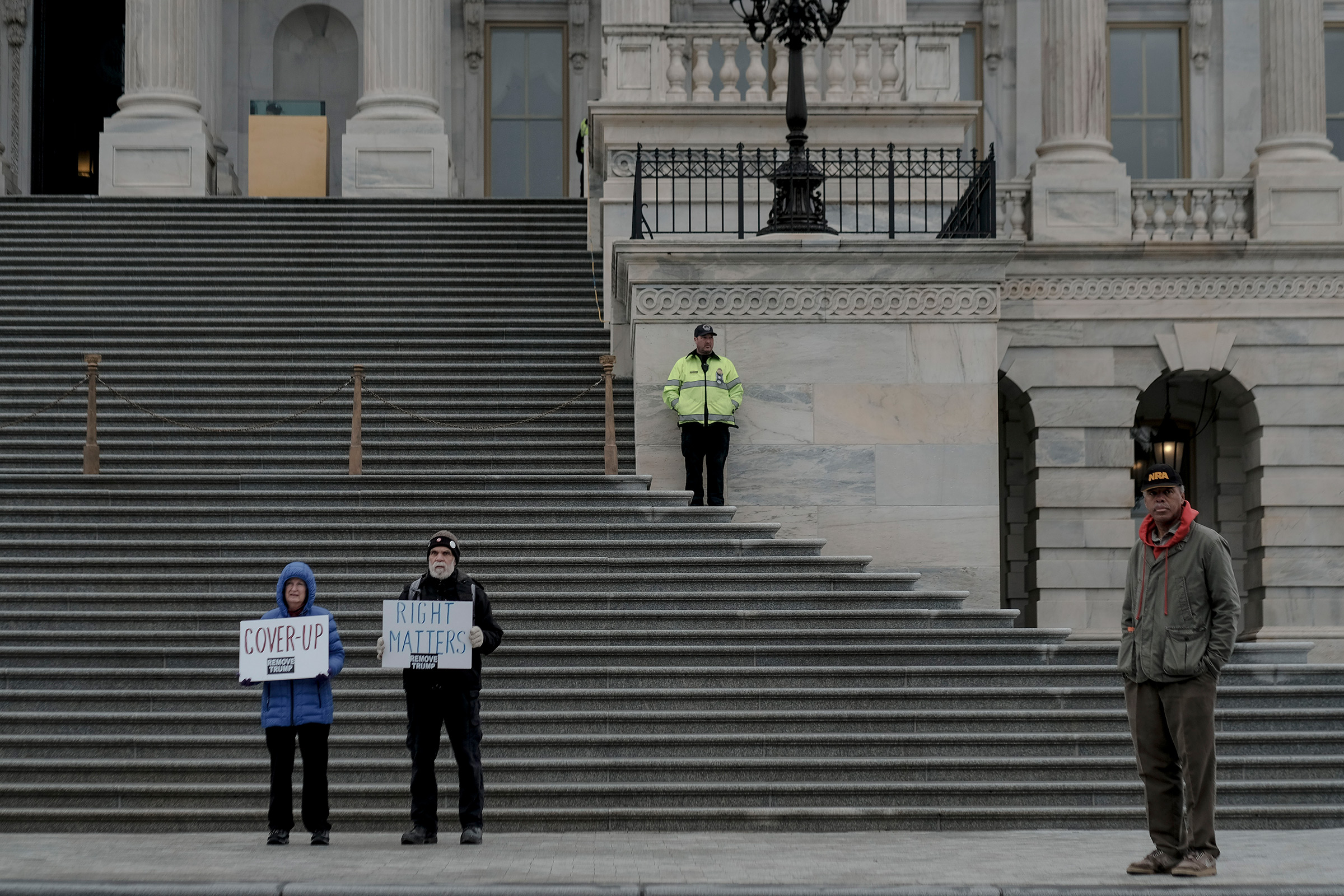 A few protestors demonstrate outside the senate chamber during the impeachment trial Saturday morning in Washington, D.C., on Jan. 25, 2020.
